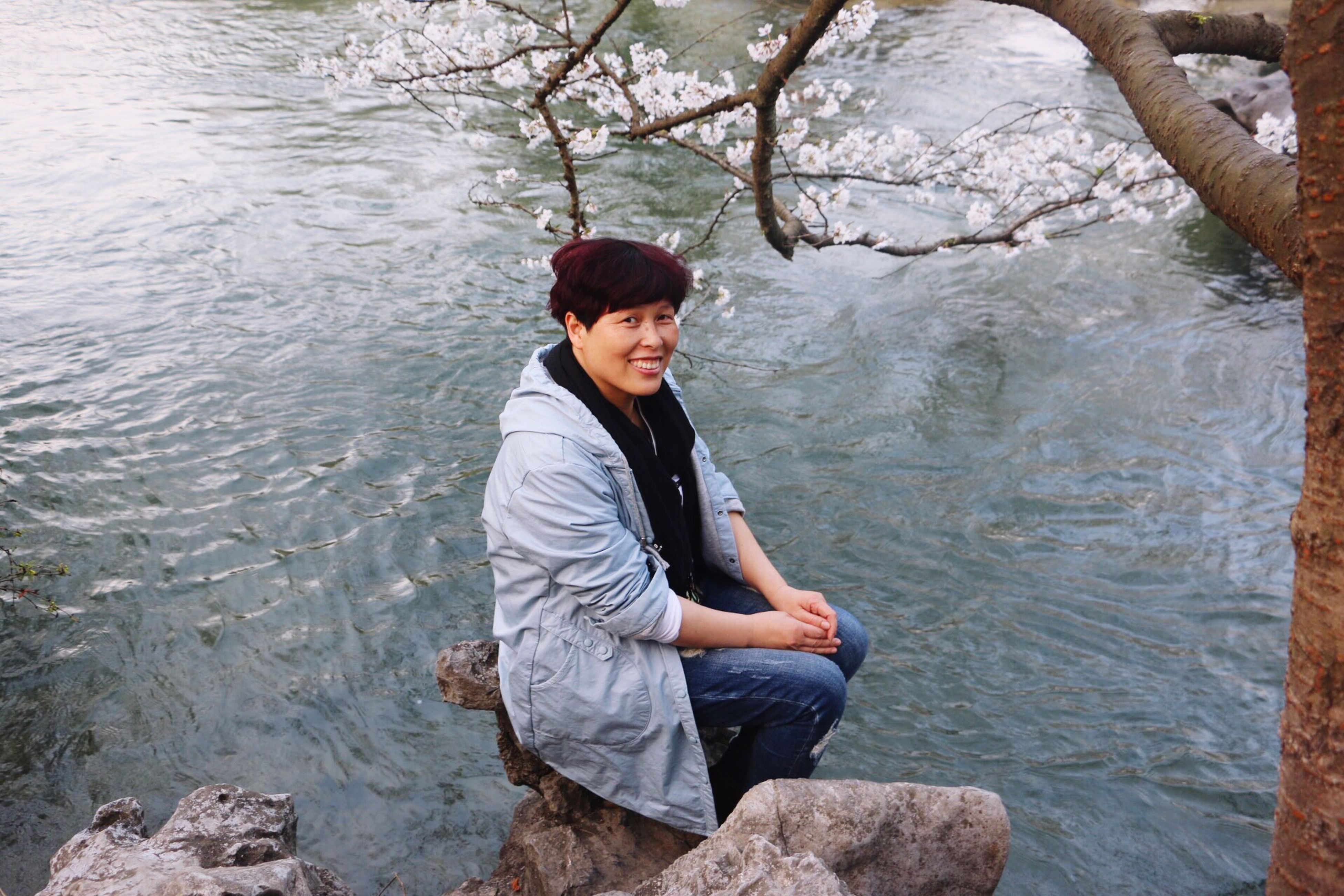water, lifestyles, leisure activity, casual clothing, young adult, person, young men, full length, lake, standing, three quarter length, river, nature, sitting, rock - object, tree, portrait, vacations