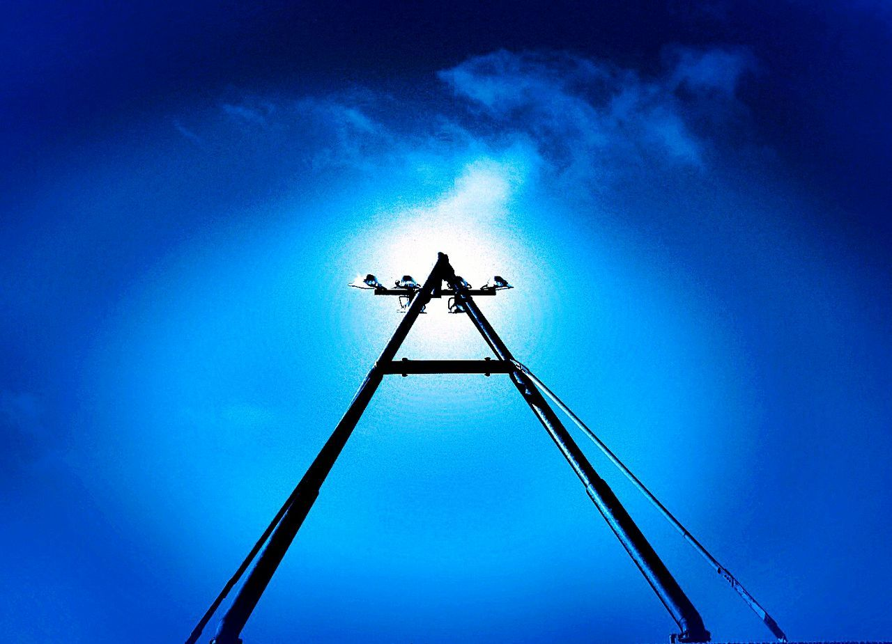 low angle view, blue, outdoors, no people, silhouette, sky, day