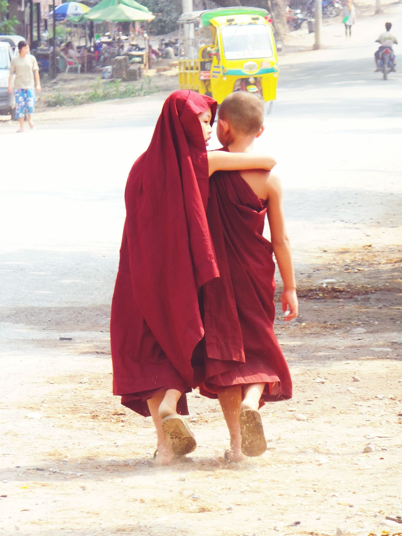 Friends. Full Length Lifestyles Street Rear View Togetherness Novice Monks Novice Monk Going For A Walk Going To School Budhhist Monk Buddhism Friendship Friends Supportive Myanmmar
