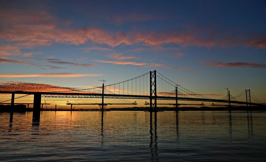 Suspension Bridge and Cable Stay Bridge on Firth of Forth. Bridge - Man Made Structure Cable-stayed Bridge Calm Engineering Sky Sunset Suspension Bridge Tranquil Scene Waterfront