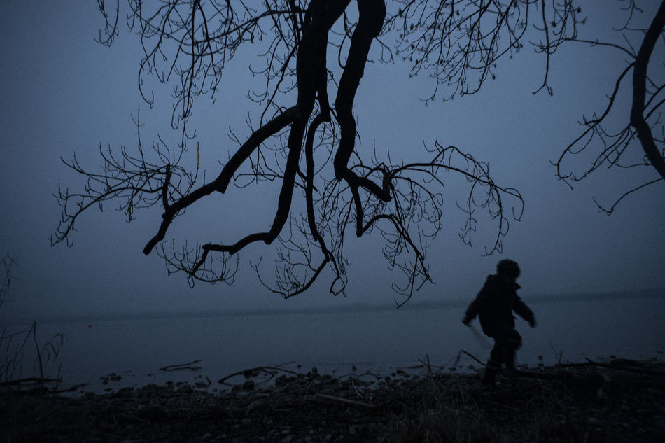 The Big Fight Bare Tree Beauty In Nature Branch Day Full Length Horizon Over Water Imagination Kids Leisure Activity Lifestyles Nature One Person Outdoors People Playing Real People Scenics Sea Silhouette Sky Tranquility Tree Tree Trunk Tripod Water