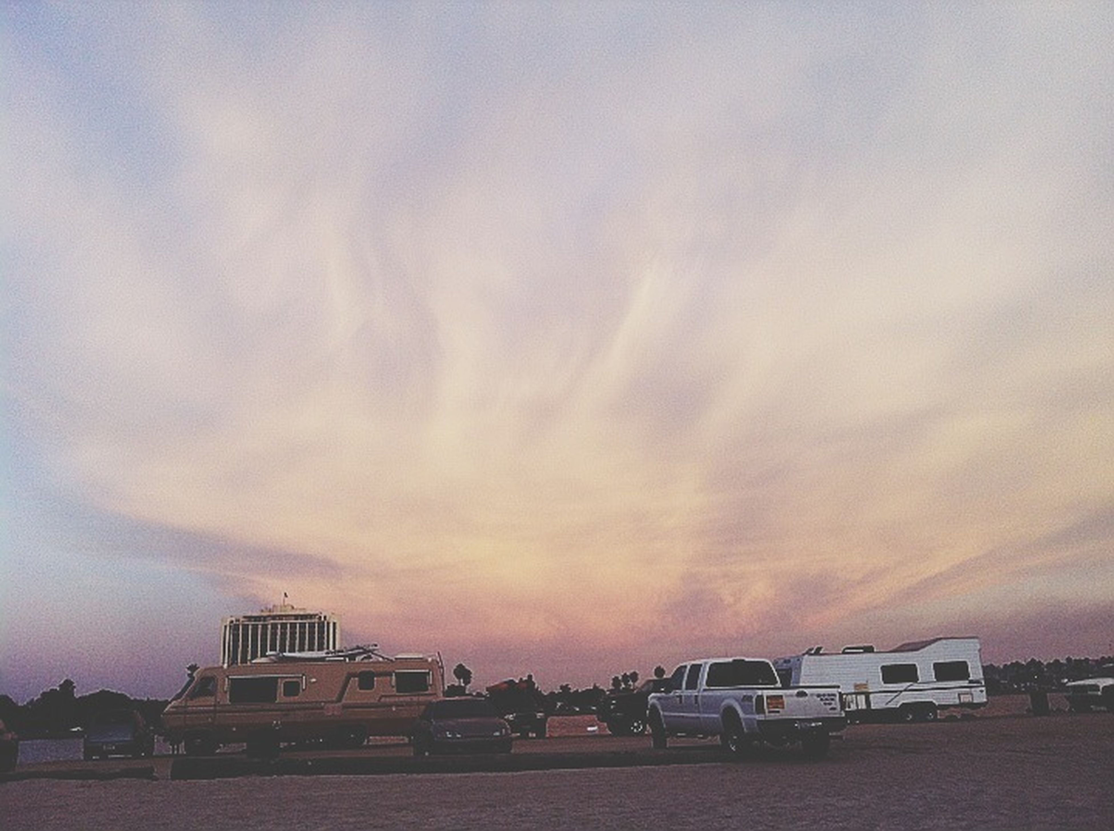 building exterior, architecture, built structure, sky, cloud - sky, sunset, cloudy, city, outdoors, building, weather, cloud, low angle view, residential structure, house, car, overcast, dusk, no people, residential building