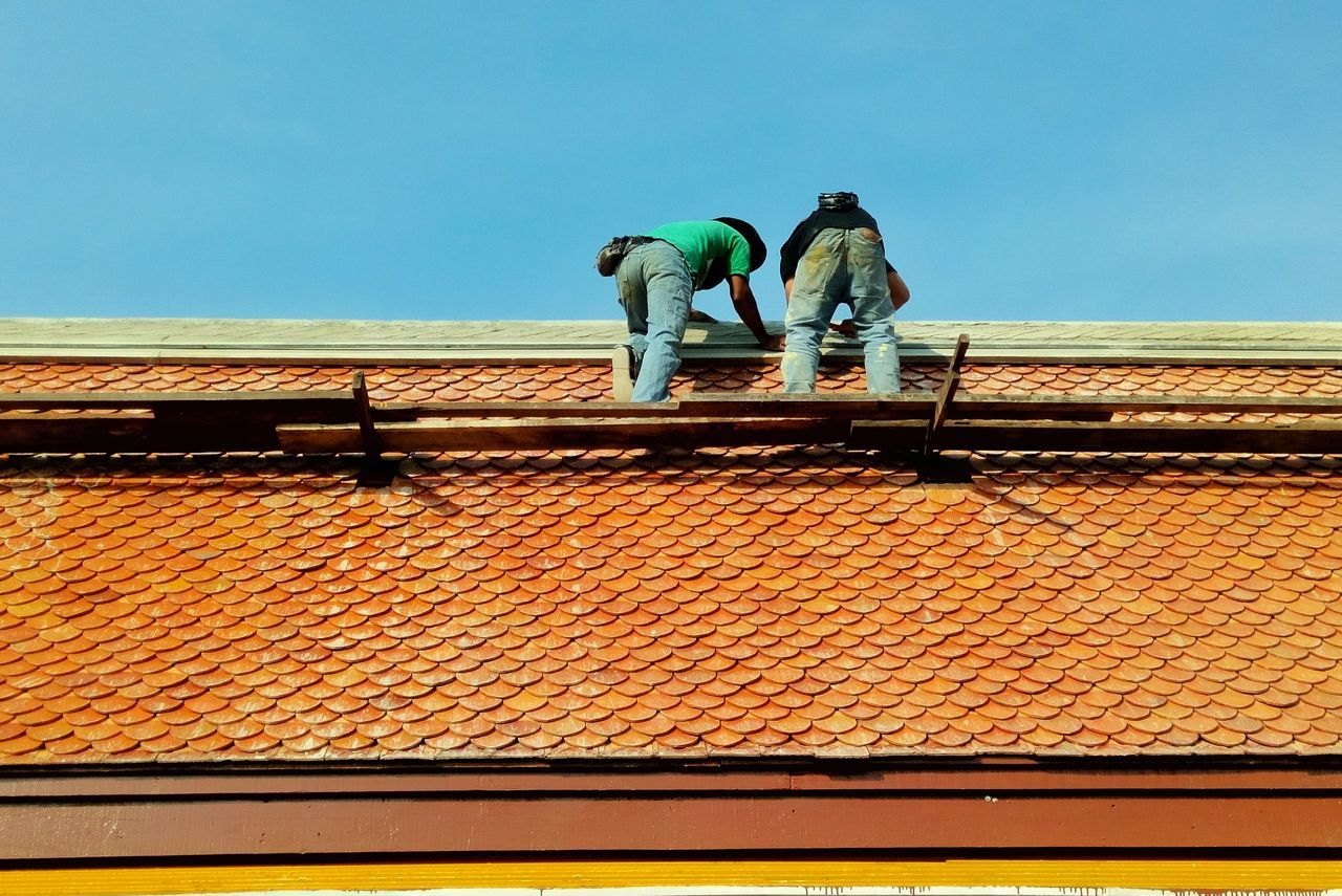Working Outdoors Men Only Men People Adults Only Real People Two People Full Length Clear Sky Adult Day Repairman Temple Roof Construction Maintenance Occupation