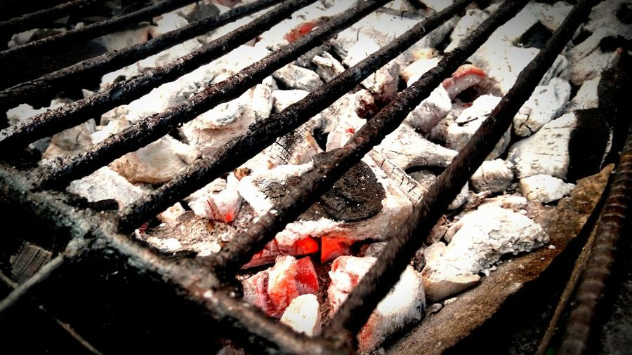 Warmth from a real fire always feels the best. Barbecue Grill Coal Charcoal Ember High Angle View Day Close-up No People Outdoors Red