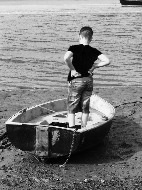 Boy on a boat Son Family Time Bnw_friday_eyeemchallenge Iphoneonly IPhoneography Mobile Photography