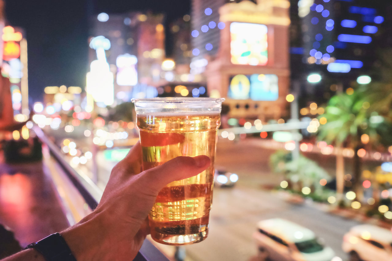 Adult Alcohol Bar Beer Boulevard Drink Drinking Glass Enjoying Life Focus On Foreground Food And Drink Freshness Holding Human Body Part Human Hand Illuminated Las Vegas Blvd Night Nightlife One Person Outdoors People Personal Perspective Refreshment Traffic Vacations