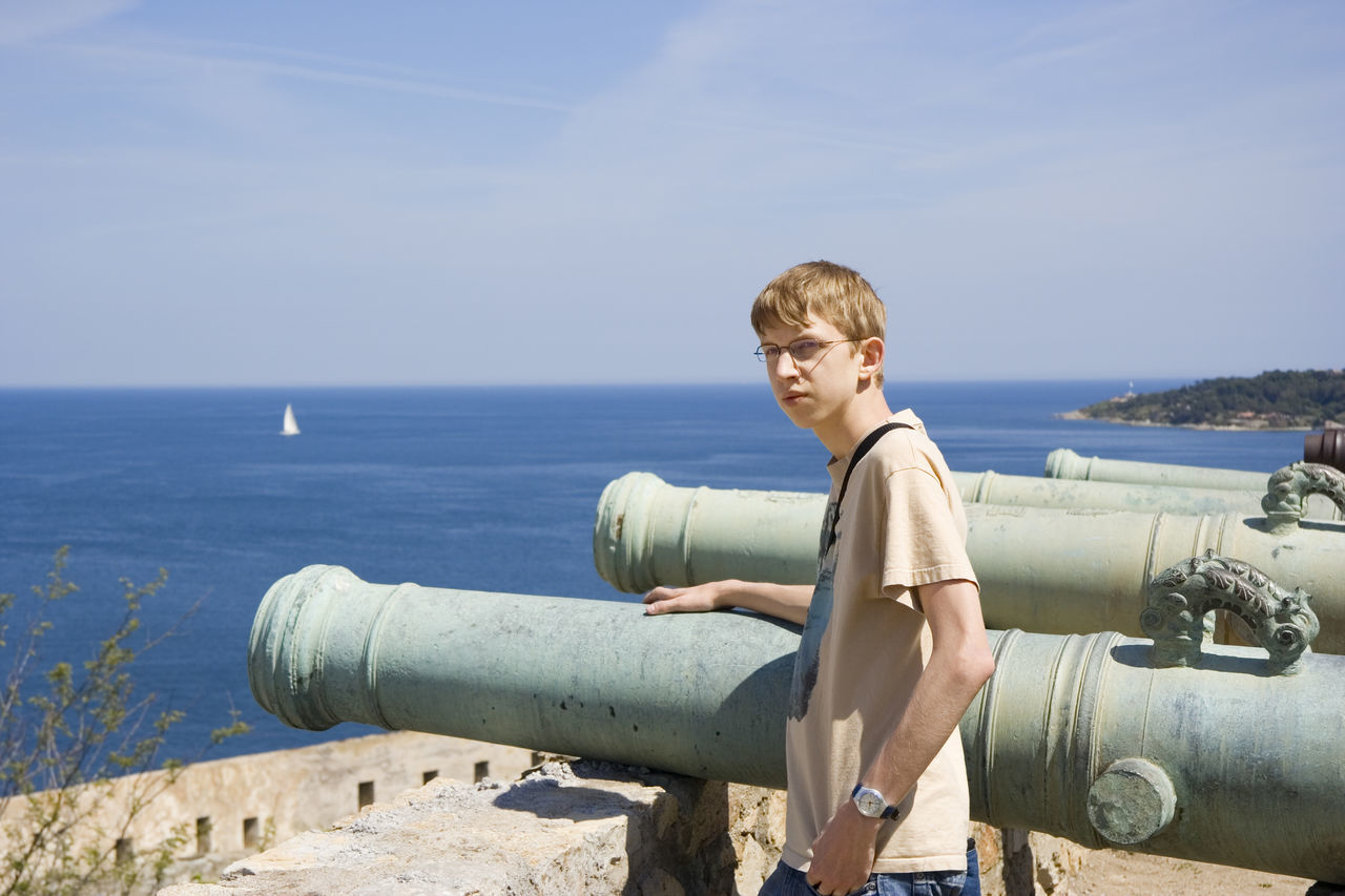 teen with gunner in citadel of saint-tropez, french riviera, mediterranean sea Adolescence  Army Battle Boy Cannon Cannons Defense Education Gunner History Mediterranean Sea Military One Boy Only One Teenage Boy Only Peace Saint-Tropez Sea Soldier Standing Teen Teenage Boy Teenager Tourist Waist Up War