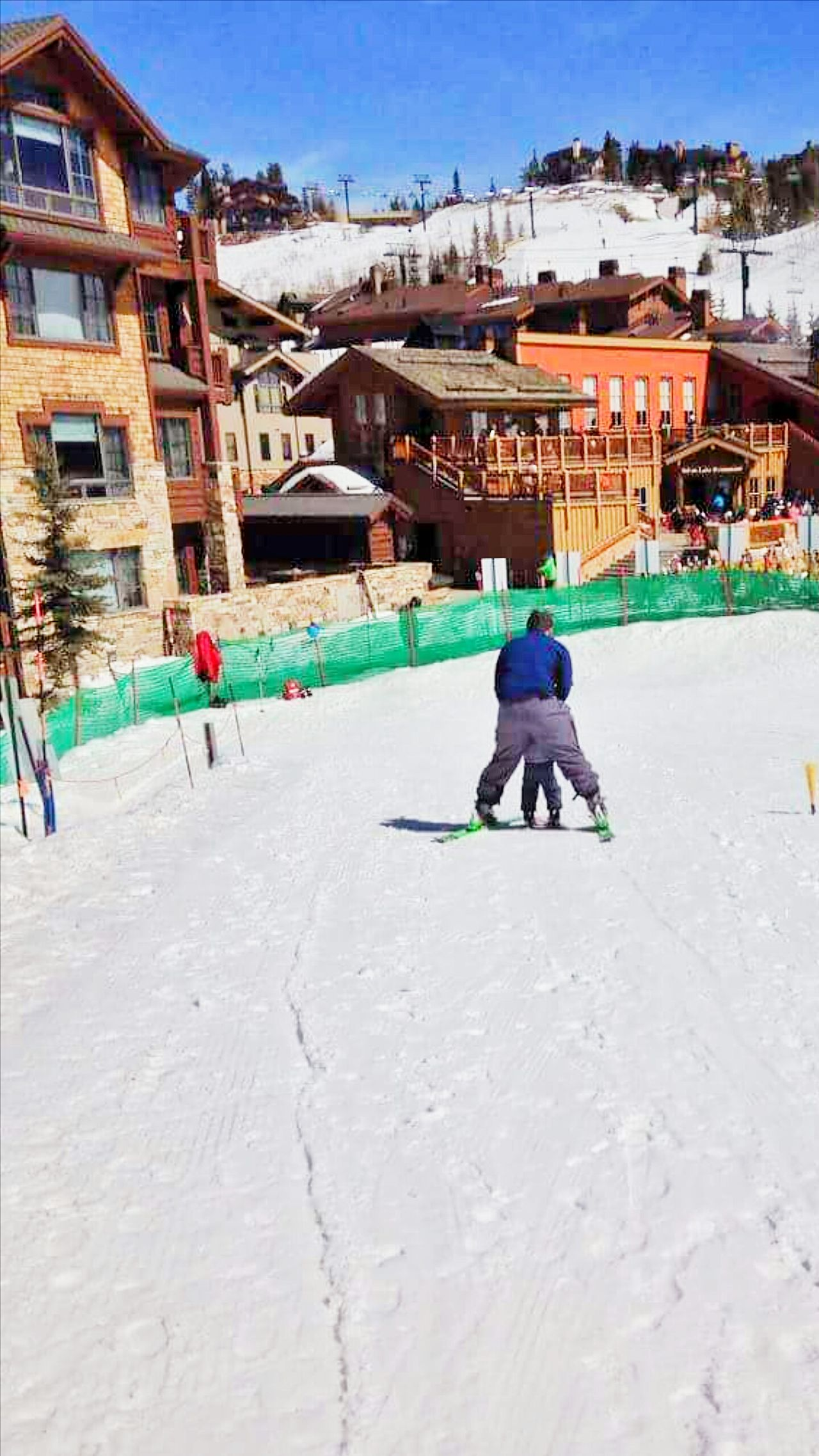 Snow Sports Winter Rear View Childhood Cold Temperature Architecture Full Length Nature Children Only Moving Moving Together Sky Resort Winter Learning Father And Son Helping Refugees Skiing Ski Resort  Winter Clothes Snowy Ground Outdoors Nature Togetherness Helping Winter Sports