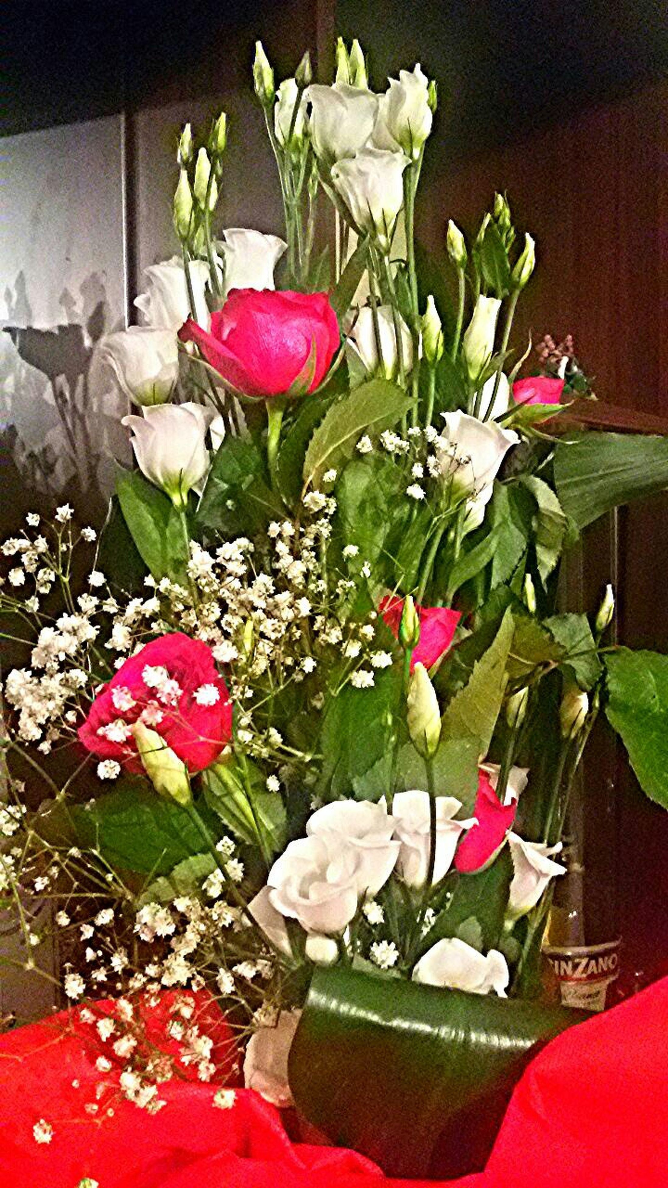 flower, petal, indoors, freshness, fragility, flower head, red, vase, growth, beauty in nature, rose - flower, decoration, close-up, bouquet, white color, nature, leaf, plant, pink color, table