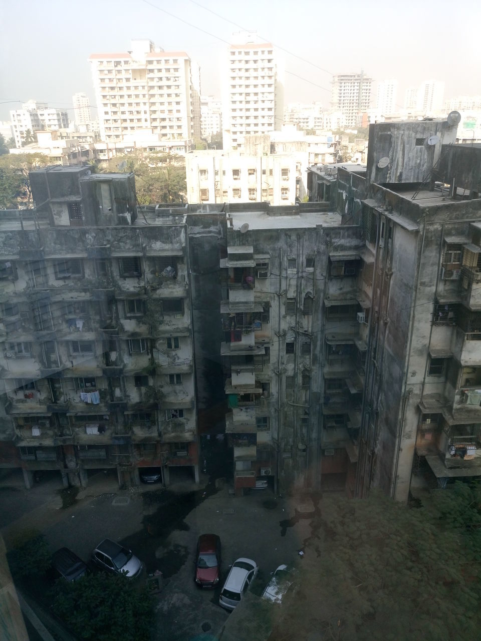architecture, building exterior, city, built structure, street, skyscraper, no people, cityscape, outdoors, day, apartment