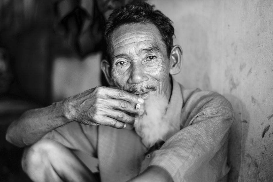 whenever i think to quit smoking, i need cigarette to think. Monochrome Photography Streetphotography Old Man Smoking Cigarette  Surabaya