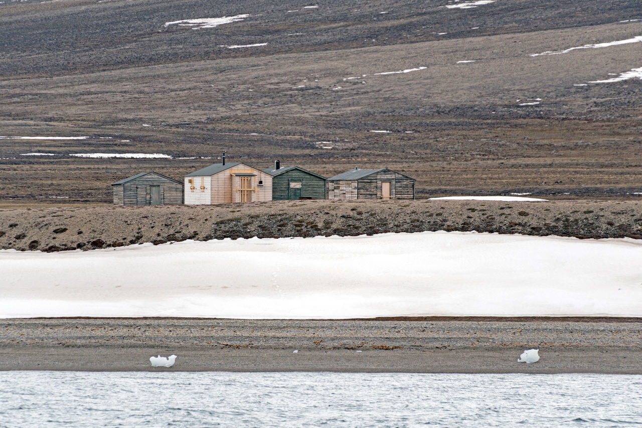 Isolated cabins in Svalbard Elg Global Warming Ice Isolated Longyearbyen Moose Norway Raindeer Abandoned Arctic Day Glacier Global Seed Vault Mining No People North Outdoors Svalbard
