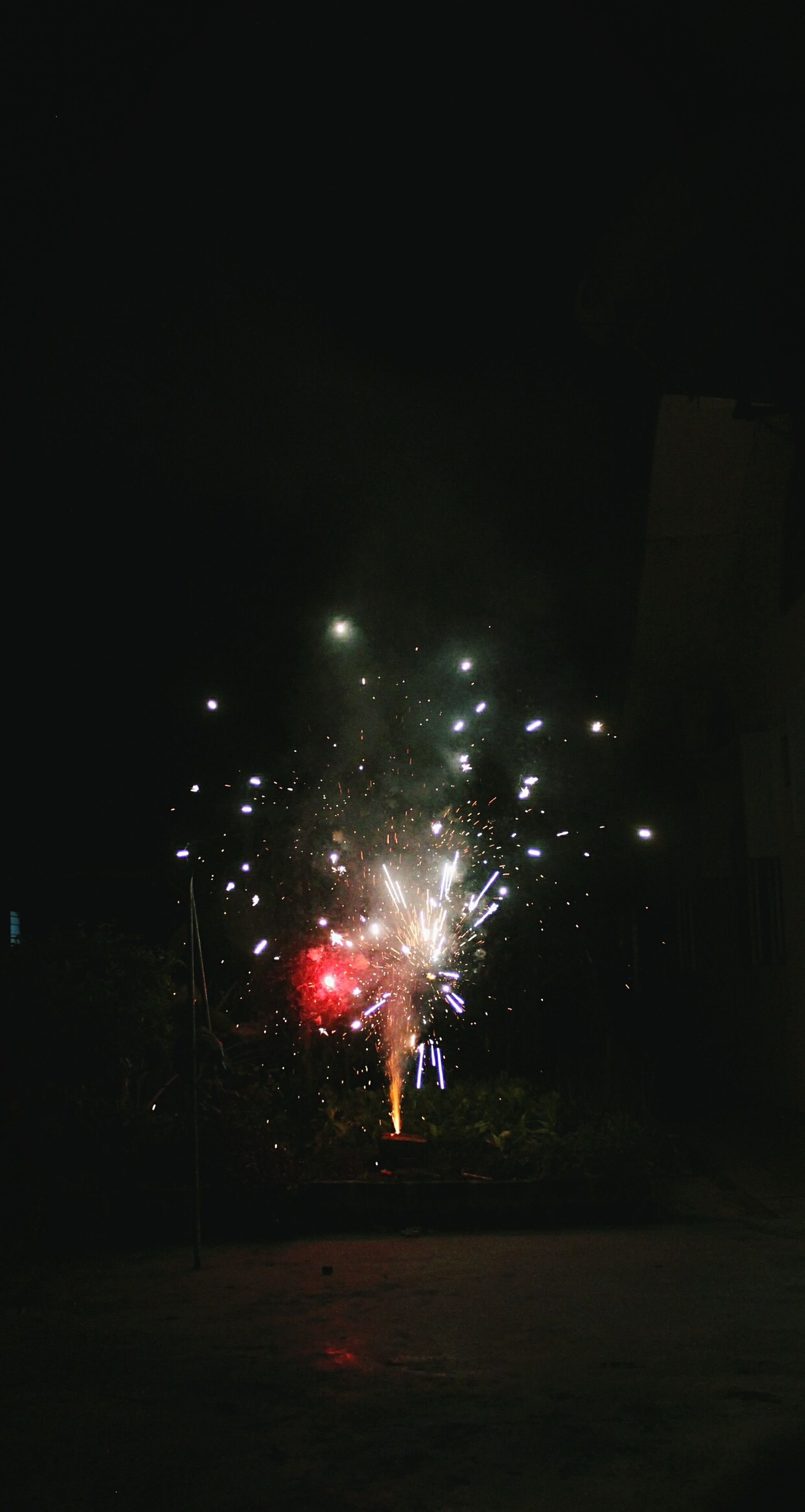 night, illuminated, celebration, firework - man made object, firework display, arts culture and entertainment, exploding, city, multi colored, no people, outdoors, sky, firework