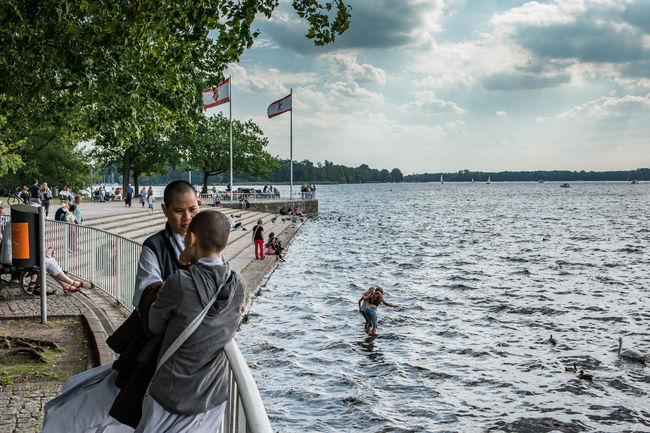 Buddist Monks conversing by the lake shore Berlin Buddhist Monks Casual Clothing Cloud - Sky Cloudy Day Lake Leisure Leisure Activity Nature Person Relax Scenics Shore Sky Sunday Tree Wannsee Water Weekend Activities Windy