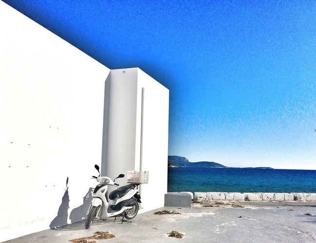 Lone rider Waiting Blue Sky Blue Sea Tranquility Ride Sea And Sky Sea Scooter Bike Day No People Clear Sky Built Structure Architecture Outdoors Building Exterior