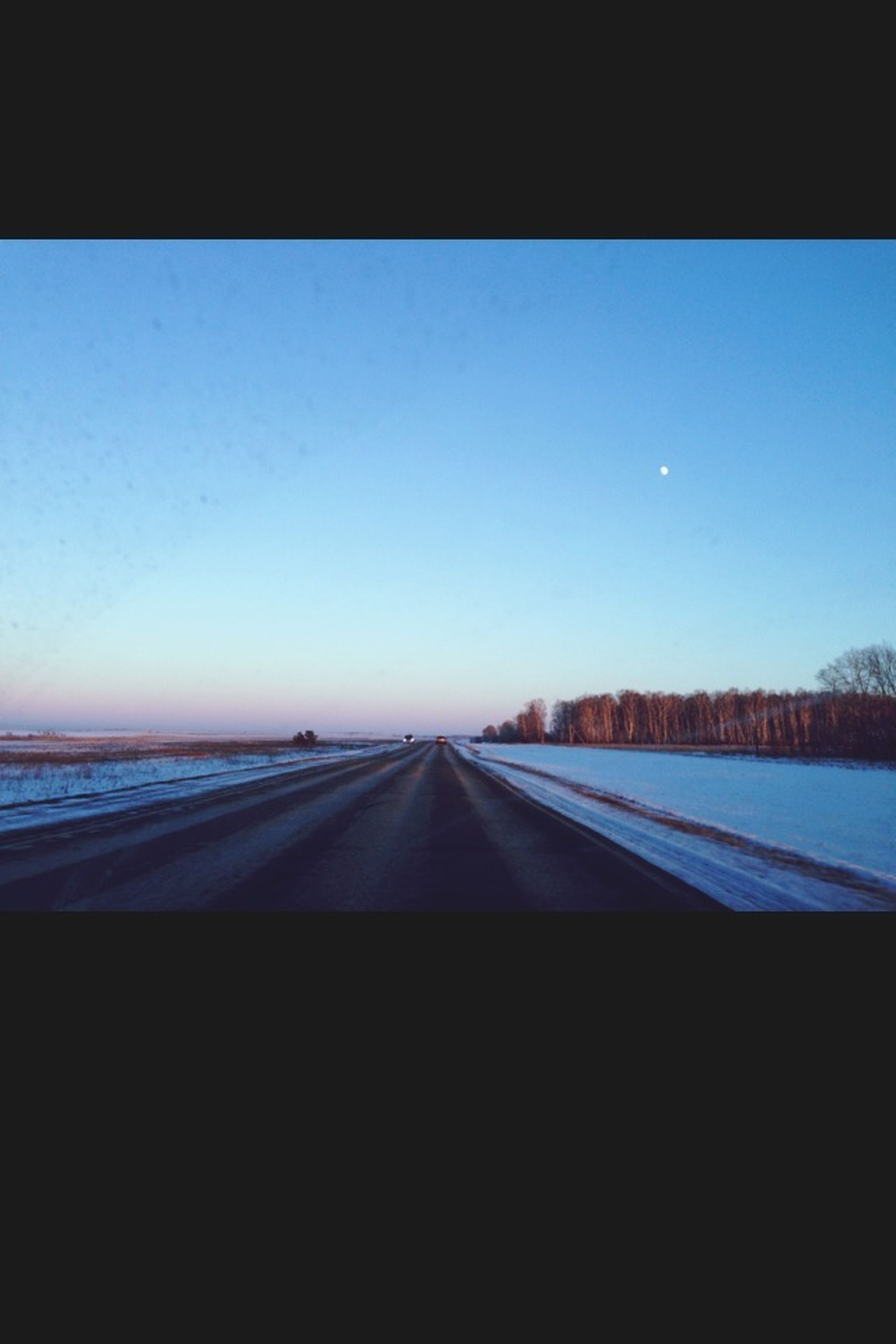 the way forward, transportation, diminishing perspective, vanishing point, clear sky, road, copy space, road marking, blue, transfer print, long, landscape, tranquil scene, sky, tranquility, country road, surface level, auto post production filter, empty, nature