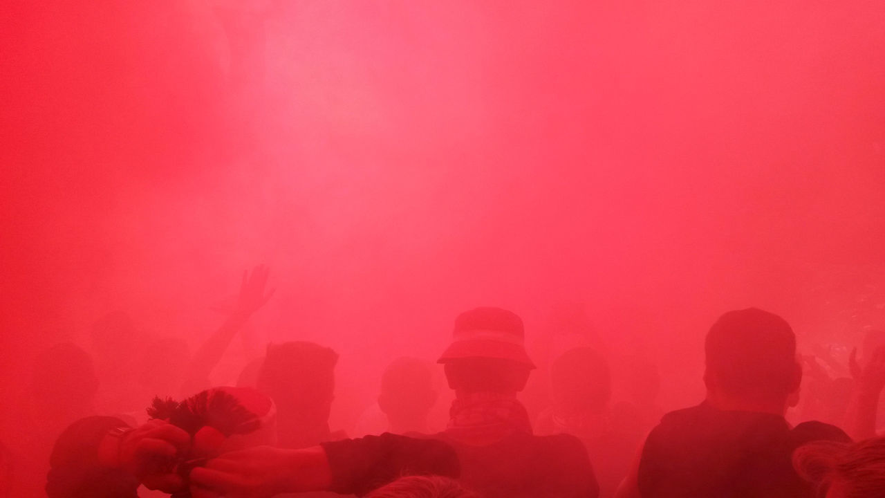 Emotions in the stadium - Fans burning smoke bomb and making good vibes Atmosphere Audience Bengal Fire Bengalo Bundesliga Crowd Emotions Fanatics Fans Fireworks Flare Fog Football Germany Mood People Pink Color Pyro Pyrotechnics Red Smoke Soccer Stadium Ultras Vibes