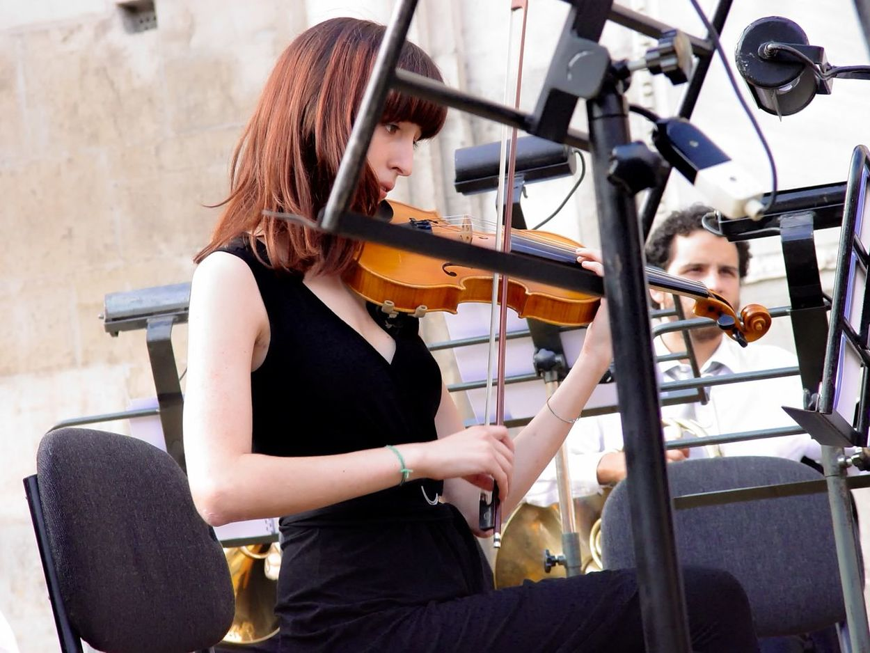 Gran Ballo Estense Adult Adults Only Beauty Day Duomo Di Modena Long Hair Musical Instrument Musician One Person One Woman Only One Young Woman Only Outdoors People Piazza Grande Playing Rehearsing Sitting Violin Women Young Adult Young Women Fresh On Eyeem  TakeoverMusic