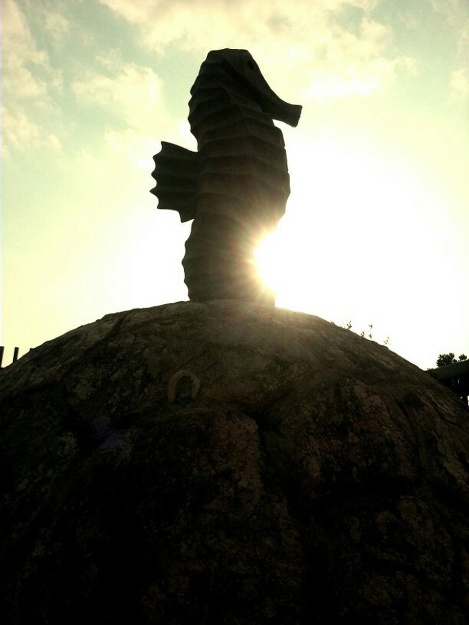 statue, low angle view, sky, sculpture, outdoors, day, cloud - sky, no people, nature, beauty in nature