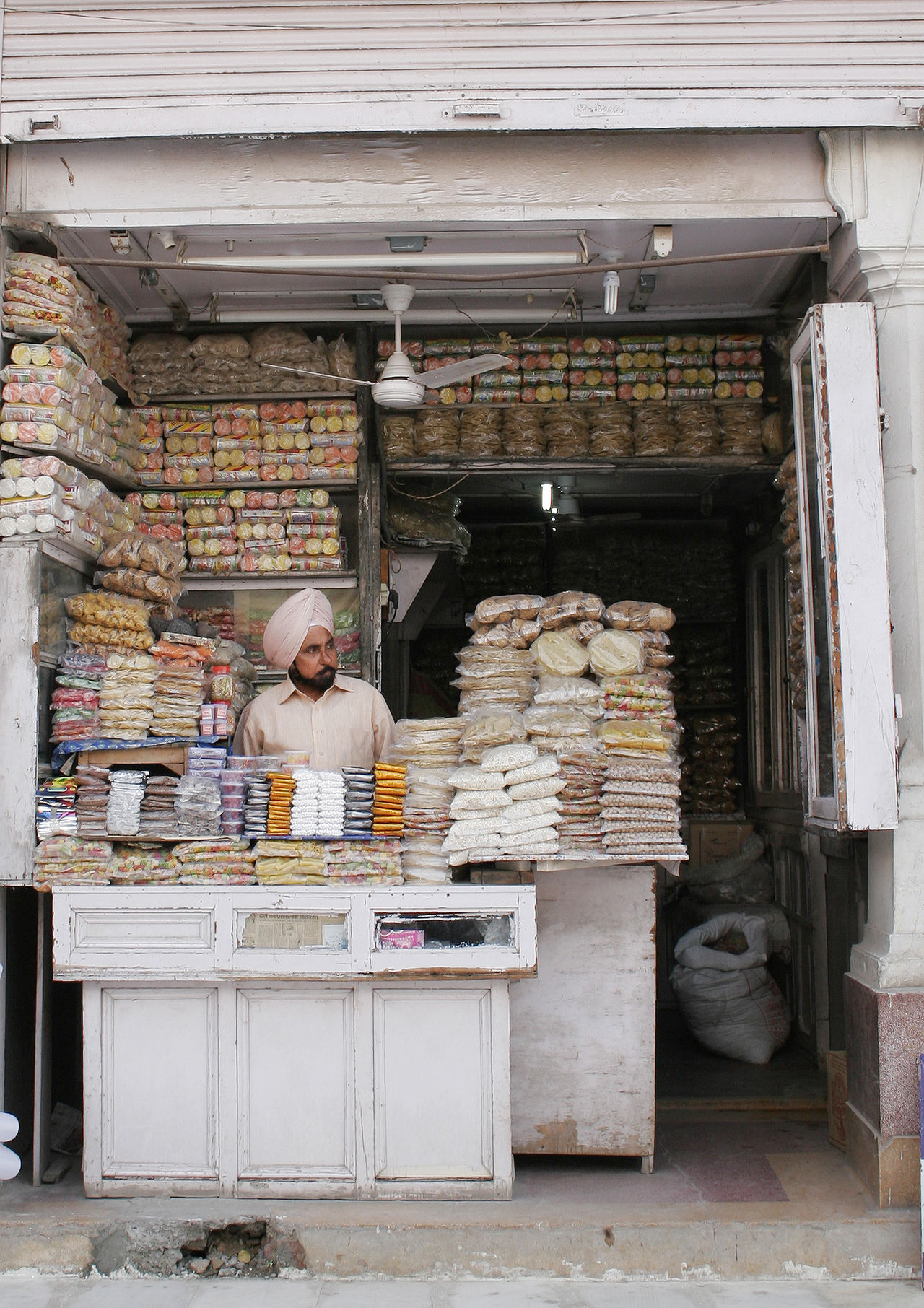 Abundance Arrangement For Sale Golden Temple India Indian Ethnicity Indian Man Turban Indian Sweets Large Group Of Objects Little Shop Market Market Stall Market Vendor Old Old Market Real People Retail  Sweet Food Sweets Turban Vendor Vibrant Colors Waiting Waiting For A Customer Telling Stories Differently