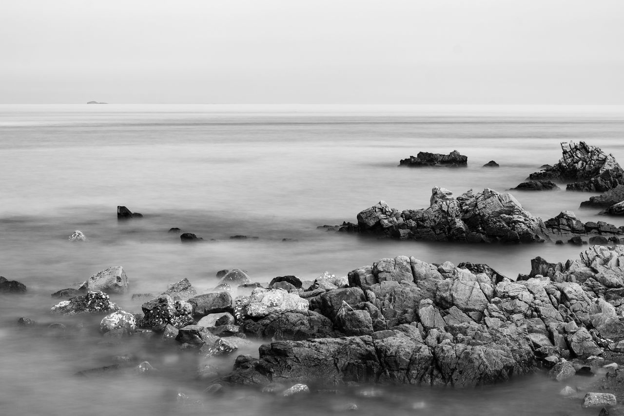calm sea Beach Black And White Day Horizon Over Water Landscape Long Exposure Monochrome No People Outdoors Peaceful Rock Sea Sky Water