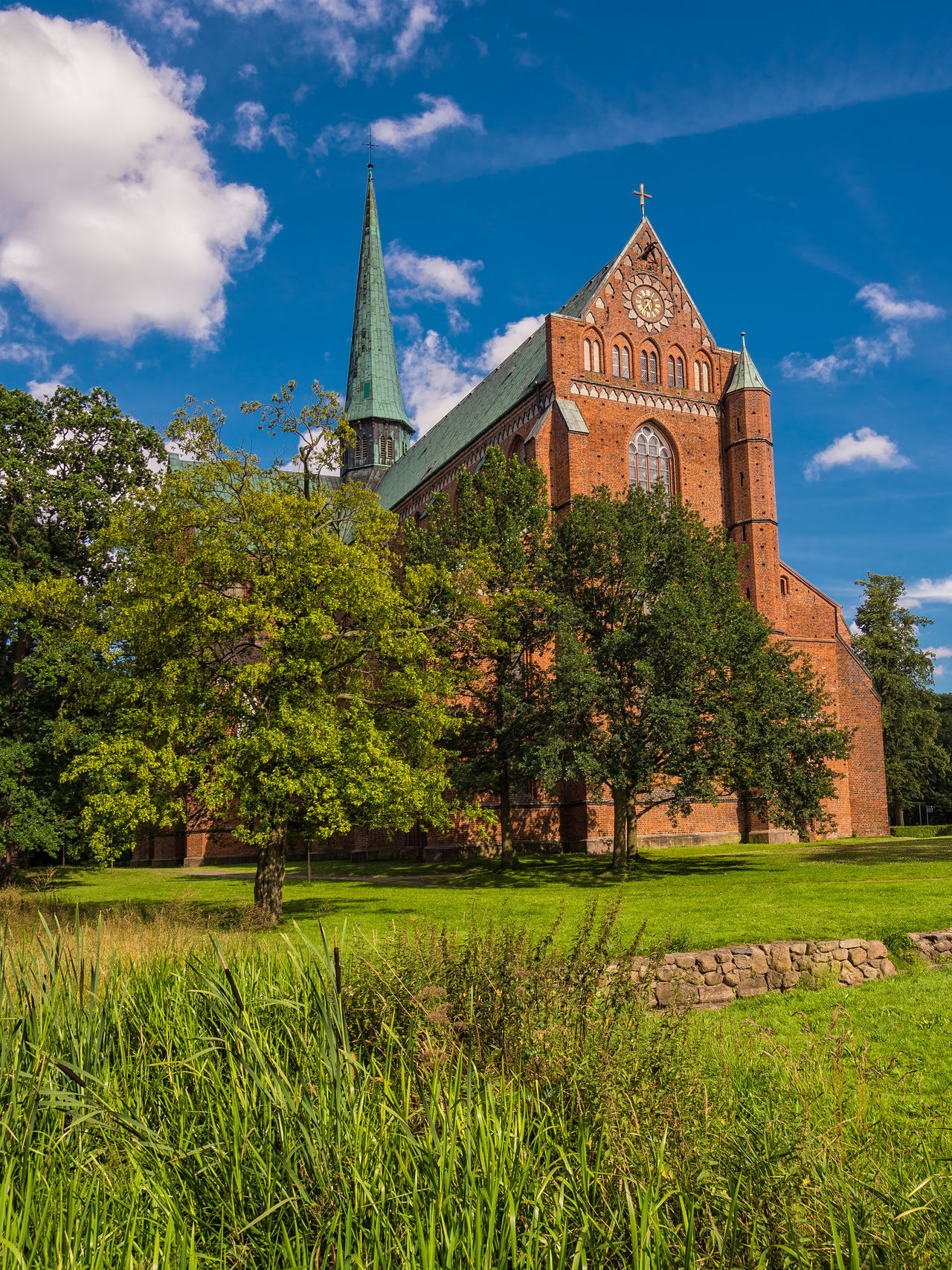 Cathedral in Bad Doberan, Germany. Architecture Bad Doberan Building Exterior Built Structure Cathedral Cloud - Sky Day History Landmark Landscape Minster Nature No People Outdoors Place Of Worship Sky Travel Destinations Tree
