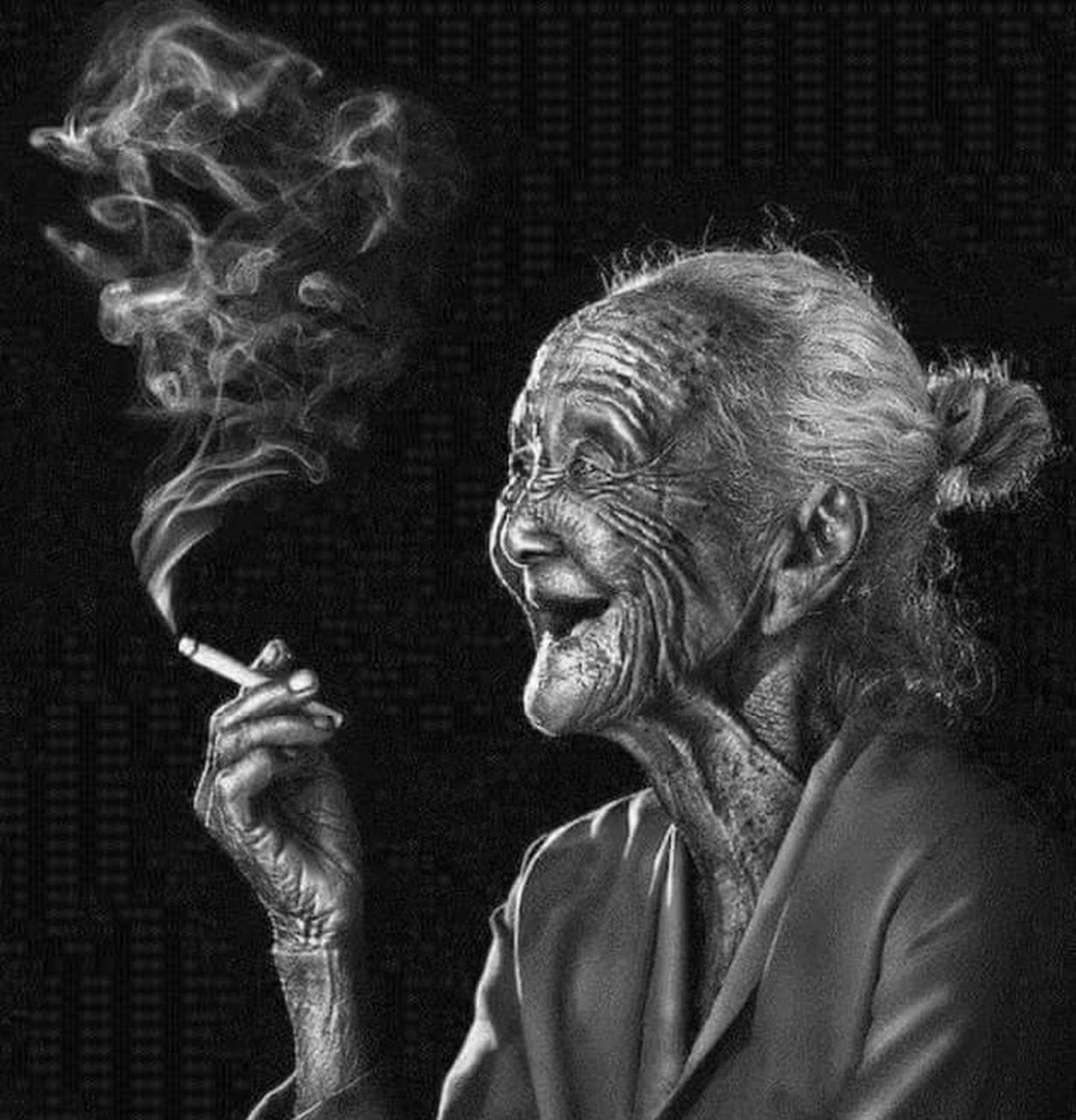 black background, smoking issues, smoking - activity, smoke - physical structure, studio shot, adult, bad habit, addiction, one person, adults only, one man only, human body part, people, headshot, indoors, only men, close-up, marijuana - herbal cannabis, cigar, human hand, males, portrait, day