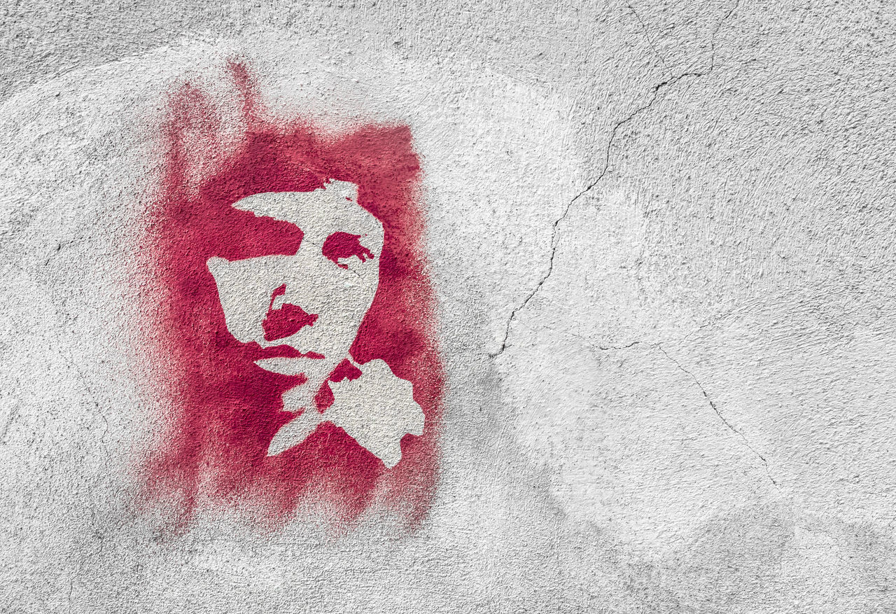 Red face on wall. Stencil graffiti. Abstract Art ArtWork Backround Bold Brush Design Drawing Drawn Face Fashion Glamour Graffiti Graphic Grunge HEAD Isolated Model Paint Plaster Red Stencil Style Vintage Wall
