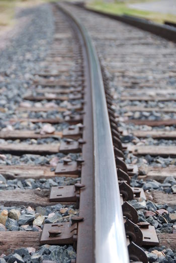 Close-up Day Metal Nature No People Outdoors Perspective View Rail Transportation Railroad Ties Railroad Track The Way Forward Where Does The Path Lead?