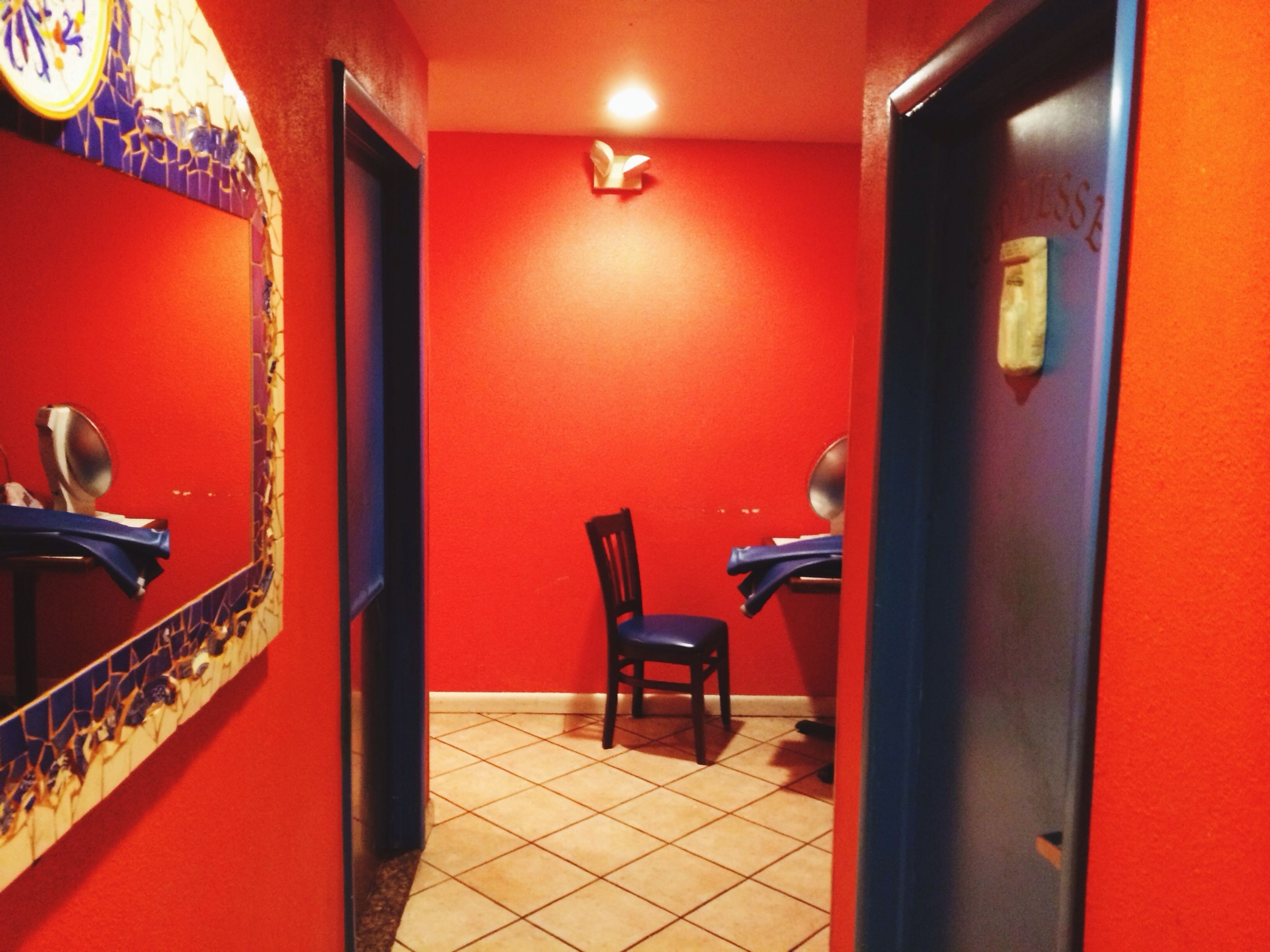 indoors, door, empty, absence, illuminated, chair, house, built structure, architecture, red, flooring, home interior, domestic room, lighting equipment, no people, tiled floor, seat, closed, furniture, wall