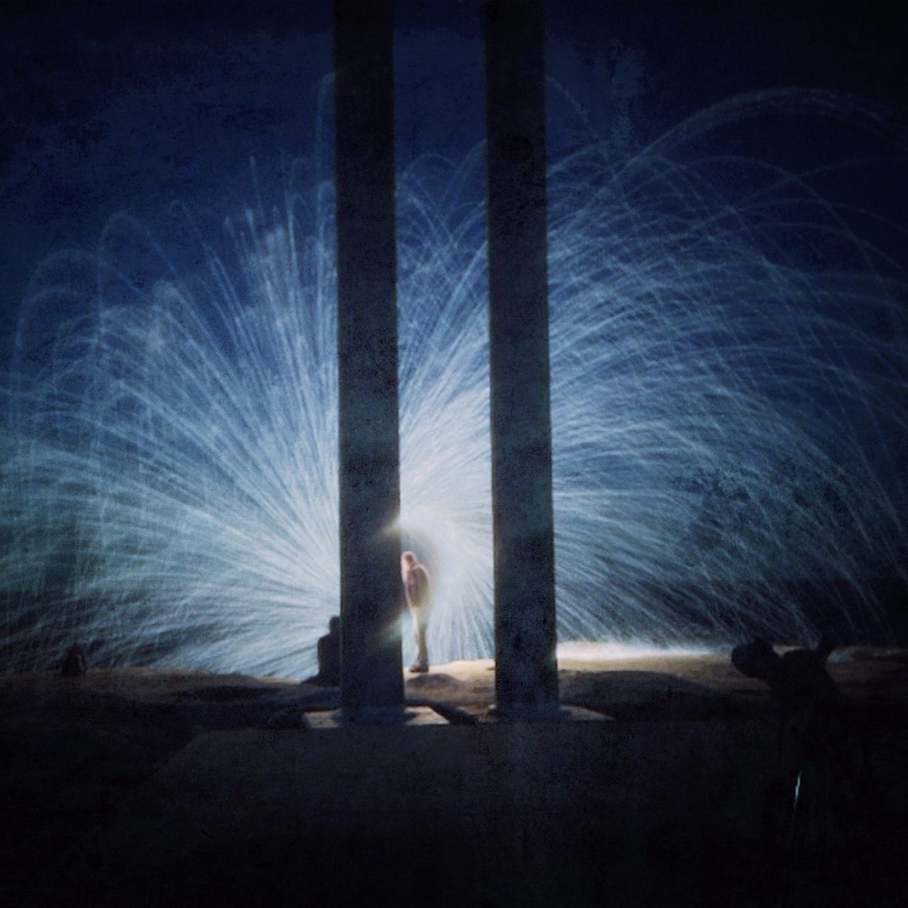 long exposure, motion, illuminated, night, real people, outdoors, standing, one person, wire wool, sky, people