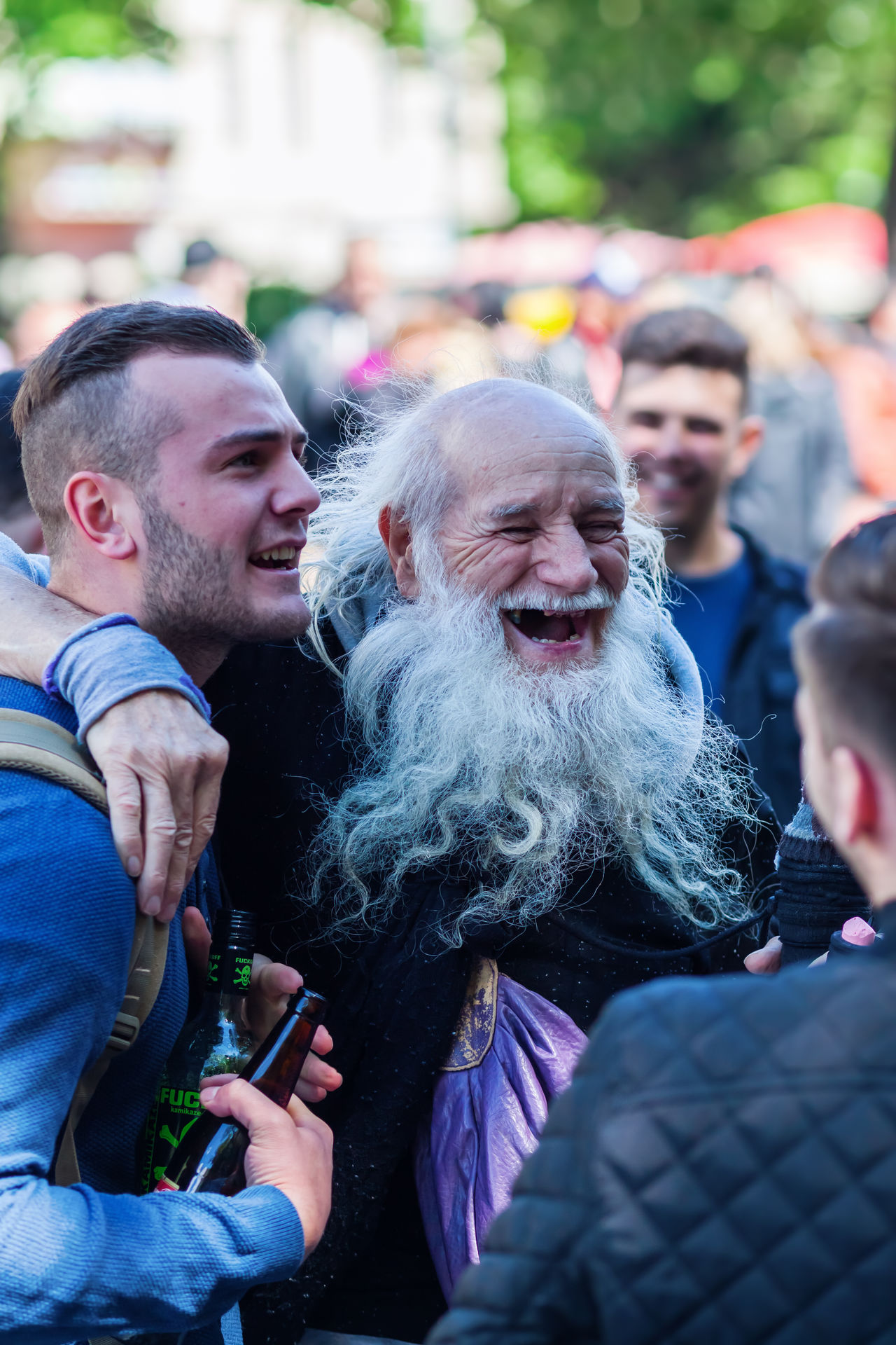 funny old man at the Carnival of Cultures in Berlin, Germany Bearded Bearded Man Berlin Carnival Of Cultures Carnival Of Cultures Berlin City City Life Close-up Day Focus On Foreground Funny Funny Faces Germany Laughing Lifestyles Men Old Man Outdoors People Real People Senior Street Photography
