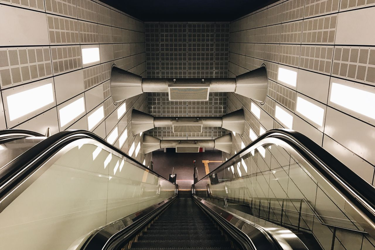 Way down Architecture Staircase Modern Built Structure Escalator Steps Indoors  Railing Steps And Staircases Moving Up Futuristic Lifestyles Illuminated Notes From The Underground EyeEm Best Shots EyeEm Gallery Public Transportation No People Nightphotography Night Lights Geometric Shape Vanishing Point Underground