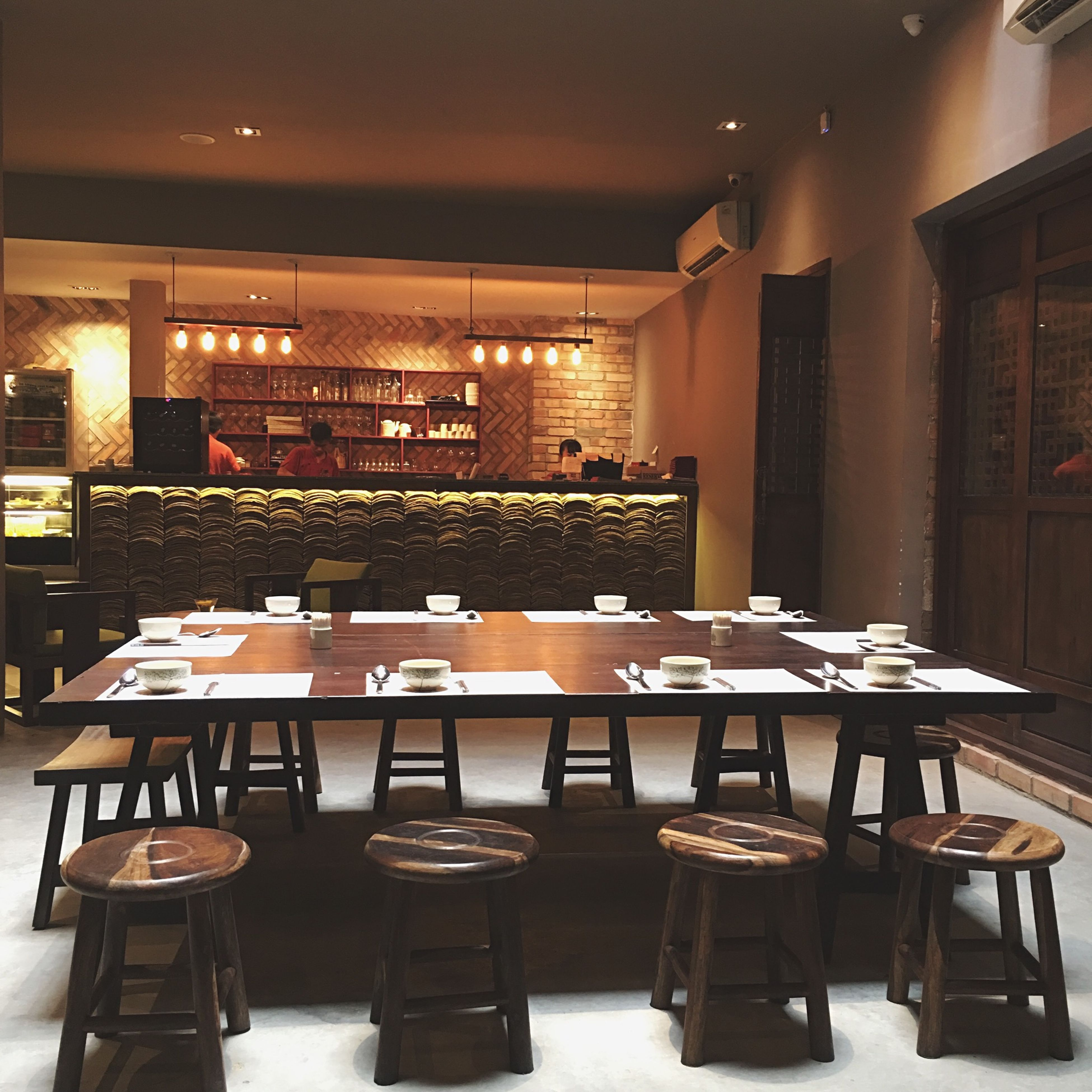 indoors, chair, empty, table, absence, illuminated, restaurant, architecture, built structure, window, lighting equipment, furniture, flooring, home interior, place setting, no people, dining table, interior, room, seat