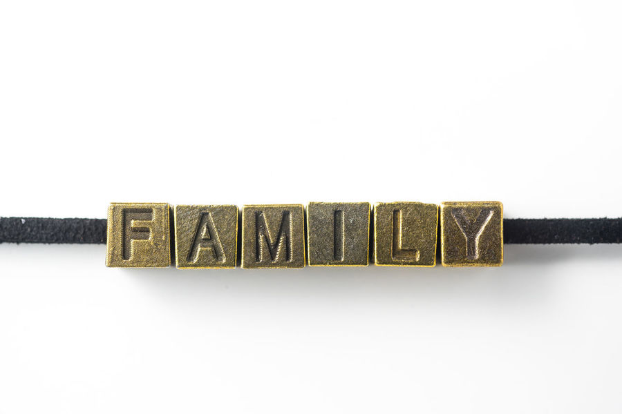 "Creative design concept - top view of metal cube word "" family "" link with line, isolated on white background Close-up Communication Family, Together, Happy, Life, Happiness, Home, Isolated, White, Background, Line, Link, Wire, Metal, Retro, Rustic, Shape, Shiny, Vintage, Copper, Cube, Necklace, Bracelet, Leather, Rope, Connect, Connection, Relation, Communication, One, Quote, Word, Le Message No People Single Word Studio Shot Sweet Food Text White Background"