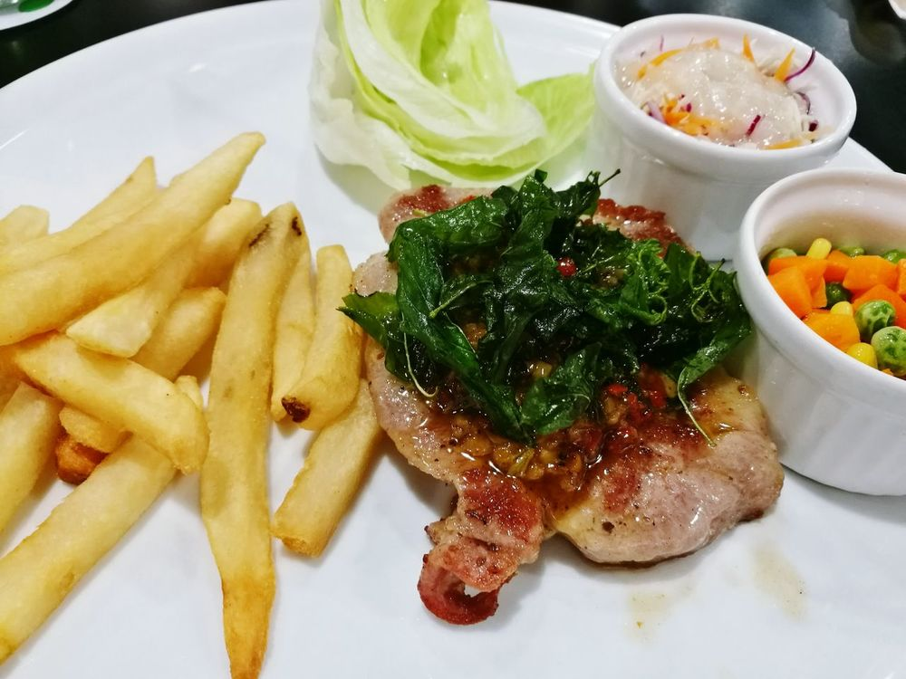Steak with spicy sauce Food And Drink French Fries No People Steak House Steak Salad Deep Fried  Close-up Bangkok Thailand.
