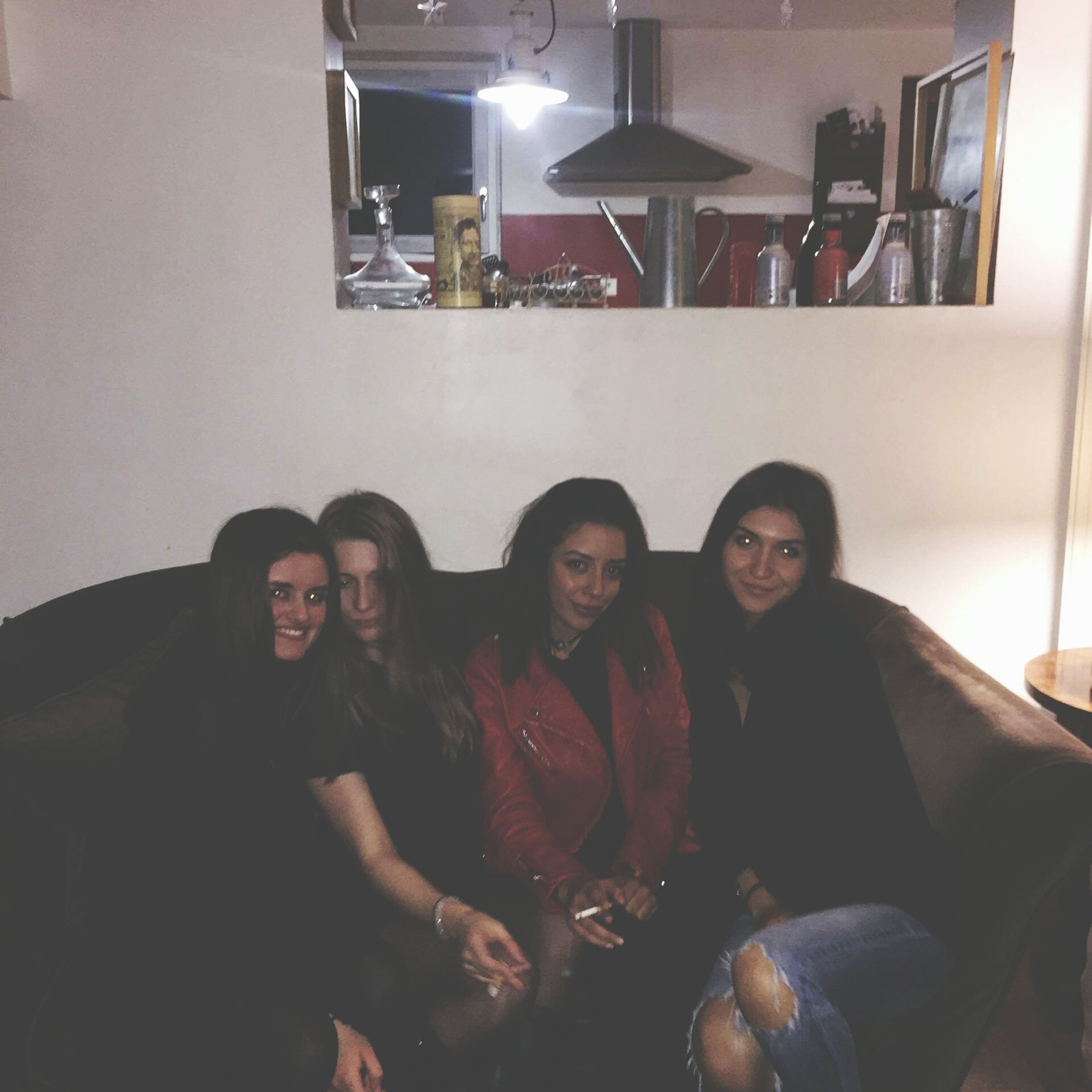 indoors, lifestyles, illuminated, night, leisure activity, friendship, smiling, movie, nightlife, sitting, real people, happiness, portrait, adults only, young adult, people, young women, film industry, togetherness, adult, happy hour