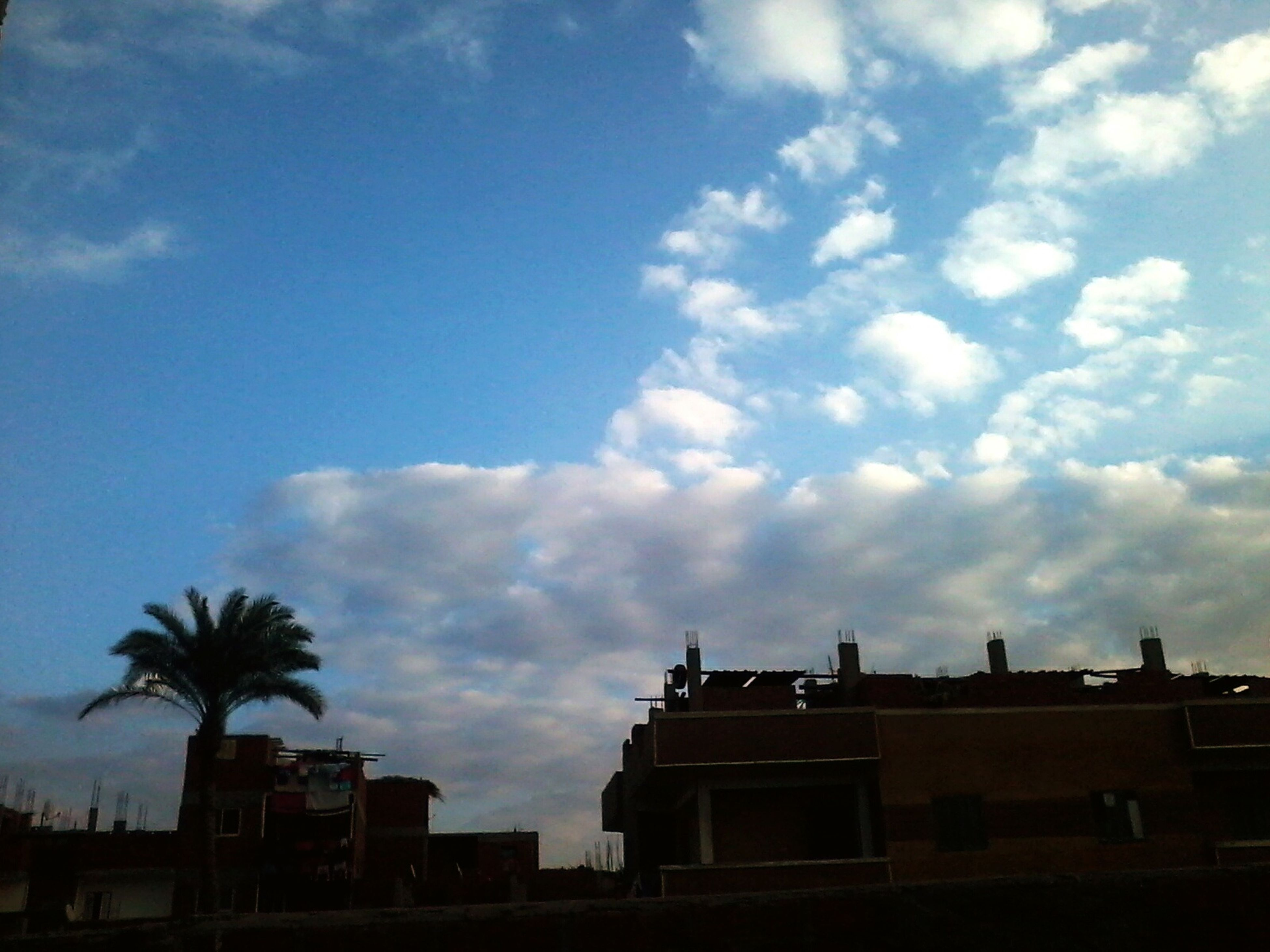 sky, architecture, built structure, cloud - sky, low angle view, building exterior, no people, outdoors, day