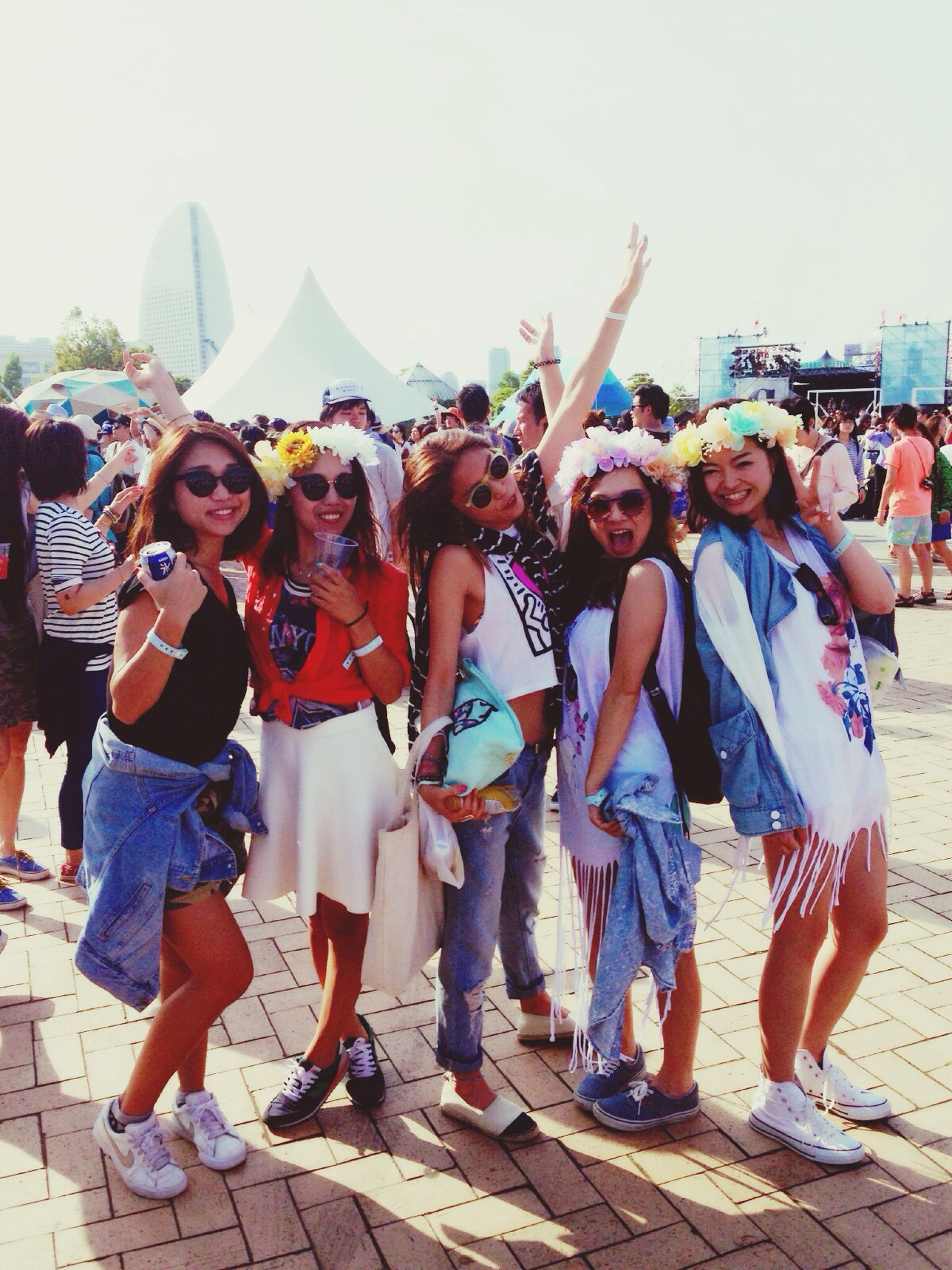 lifestyles, leisure activity, togetherness, casual clothing, friendship, full length, large group of people, person, standing, bonding, young women, happiness, love, young adult, front view, men, enjoyment, traditional clothing, vacations