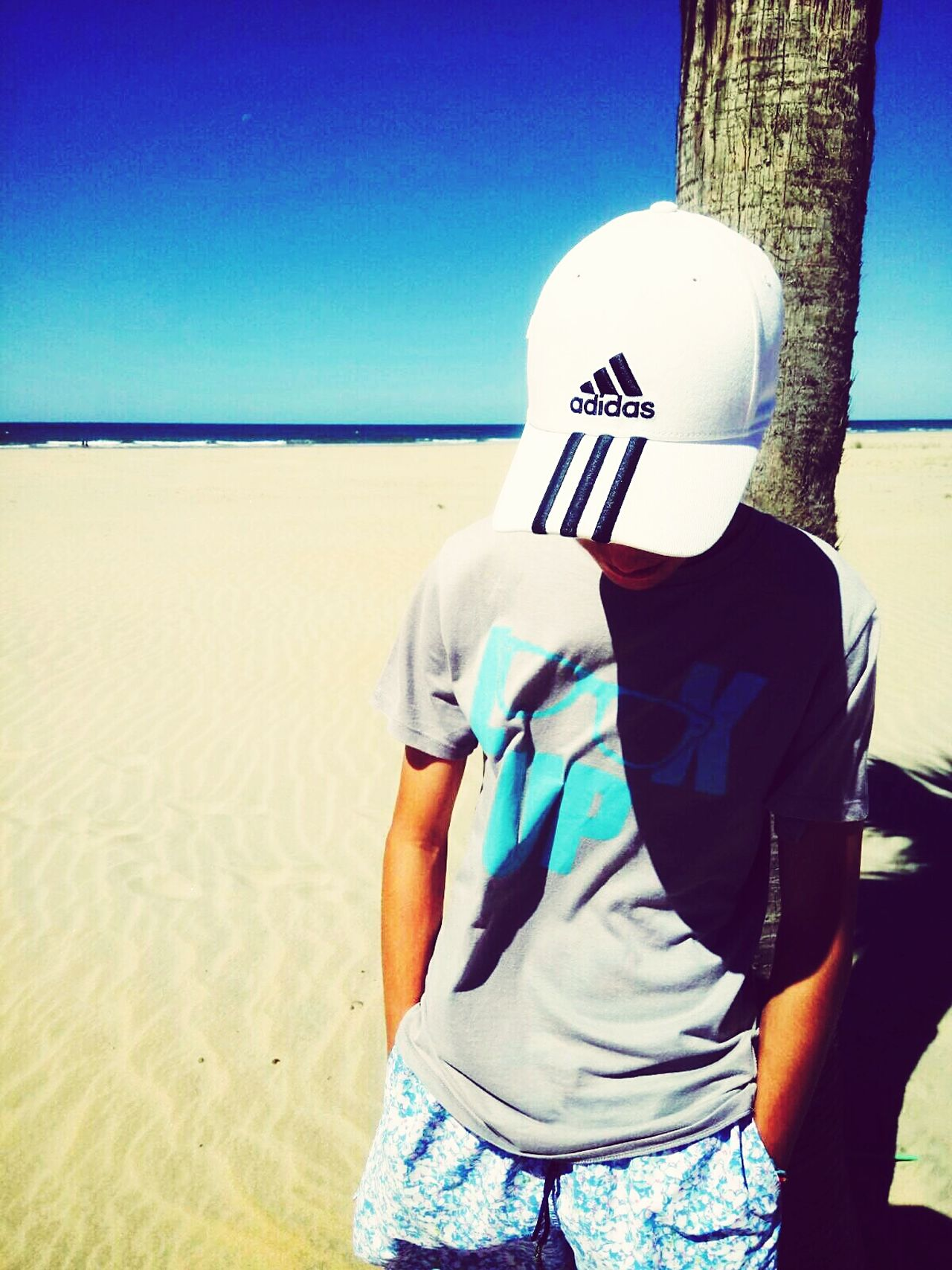 Beach People Sand Casual Clothing One Person Only Men Adult One Man Only Standing Sea Arts Culture And Entertainment Day Blue Adults Only Outdoors Sky Headwear Young Adult First Eyeem Photo