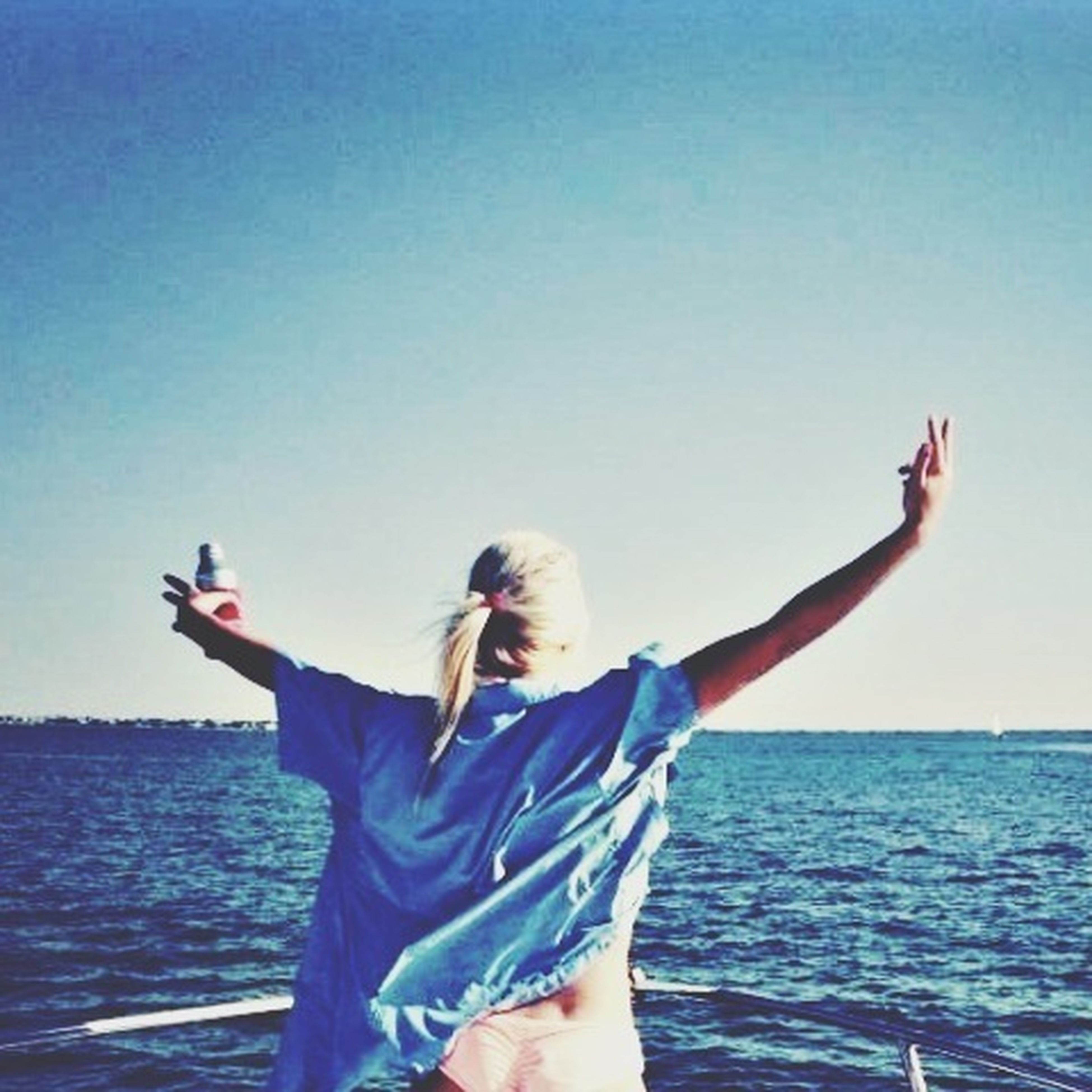 lifestyles, leisure activity, sea, water, young adult, clear sky, young women, vacations, person, horizon over water, standing, three quarter length, bikini, blue, waist up, arms raised, copy space, enjoyment