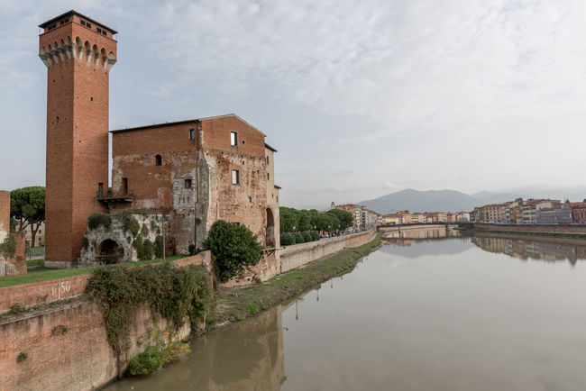 The Guelph Tower and Medici Citadel on the Arno River in Pisa, Tuscany, Italy. Architecture Building Exterior Built Structure Day History No People Outdoors Pisa Sky Travel Destinations Tree Water