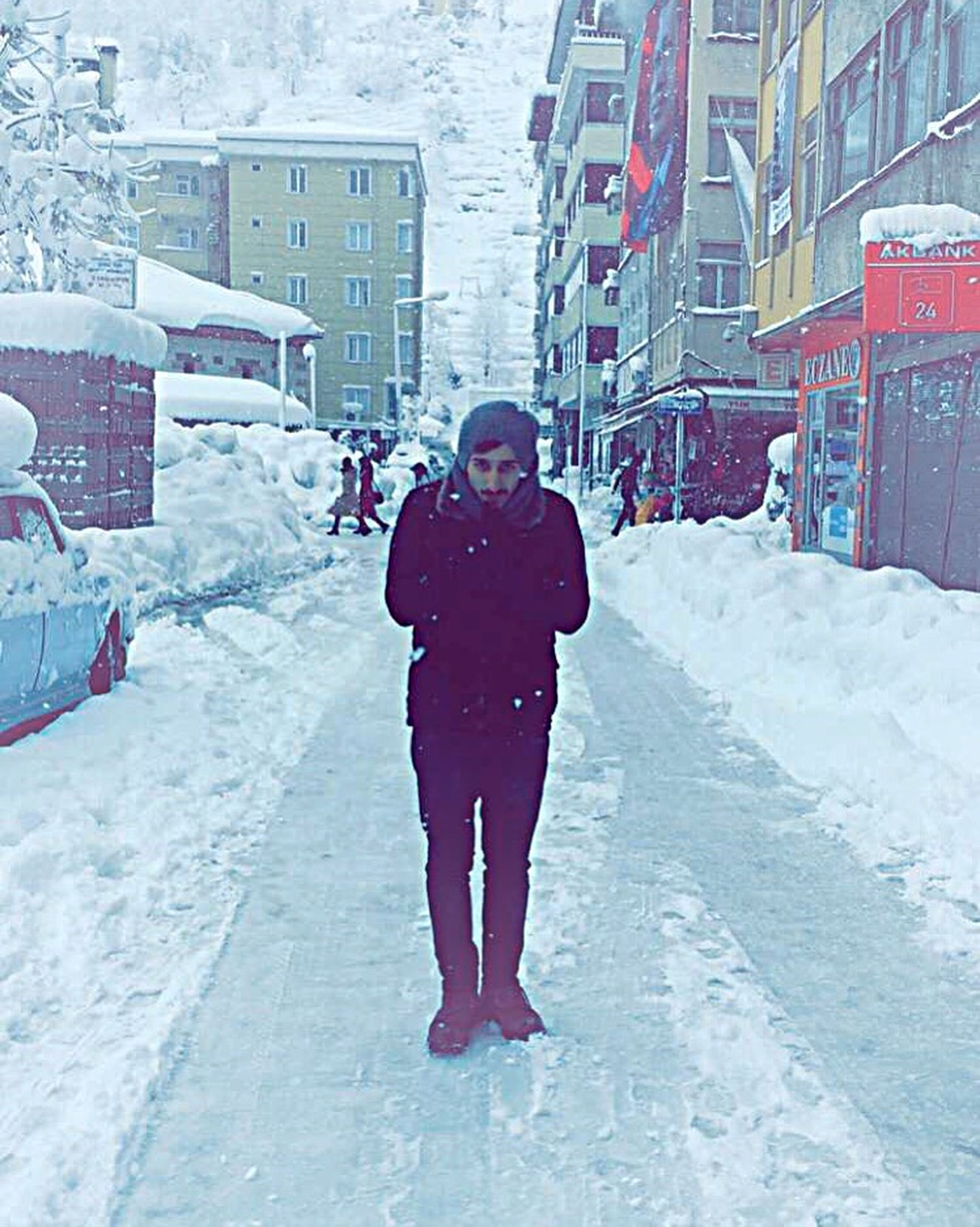 winter, snow, cold temperature, season, weather, full length, warm clothing, building exterior, lifestyles, architecture, walking, built structure, street, covering, rear view, umbrella, leisure activity, snowing