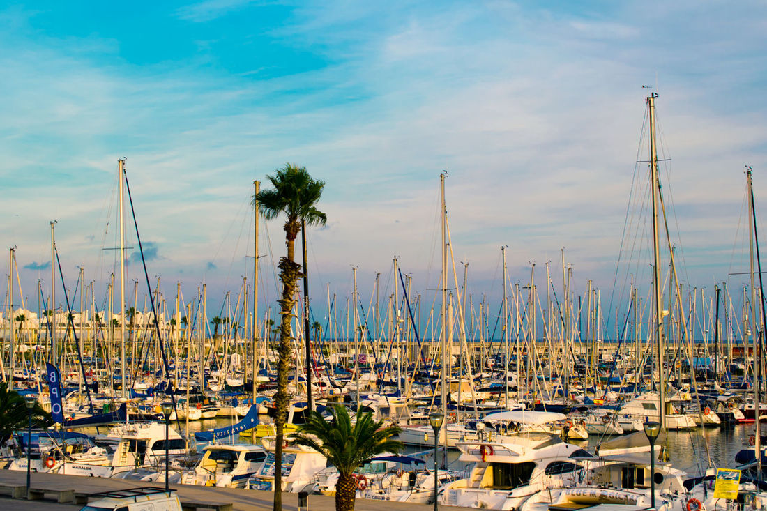 Barcelona Barceloneta Boat Commercial Dock Evening Golden Hour Mode Of Transport Nautical Vessel Rest Sailboat Sea Seaside Showplace Sightseeing Sityscape Sky SPAIN Transportation Travel Traveling Vacation Walking Around Water Waterfront Yacht