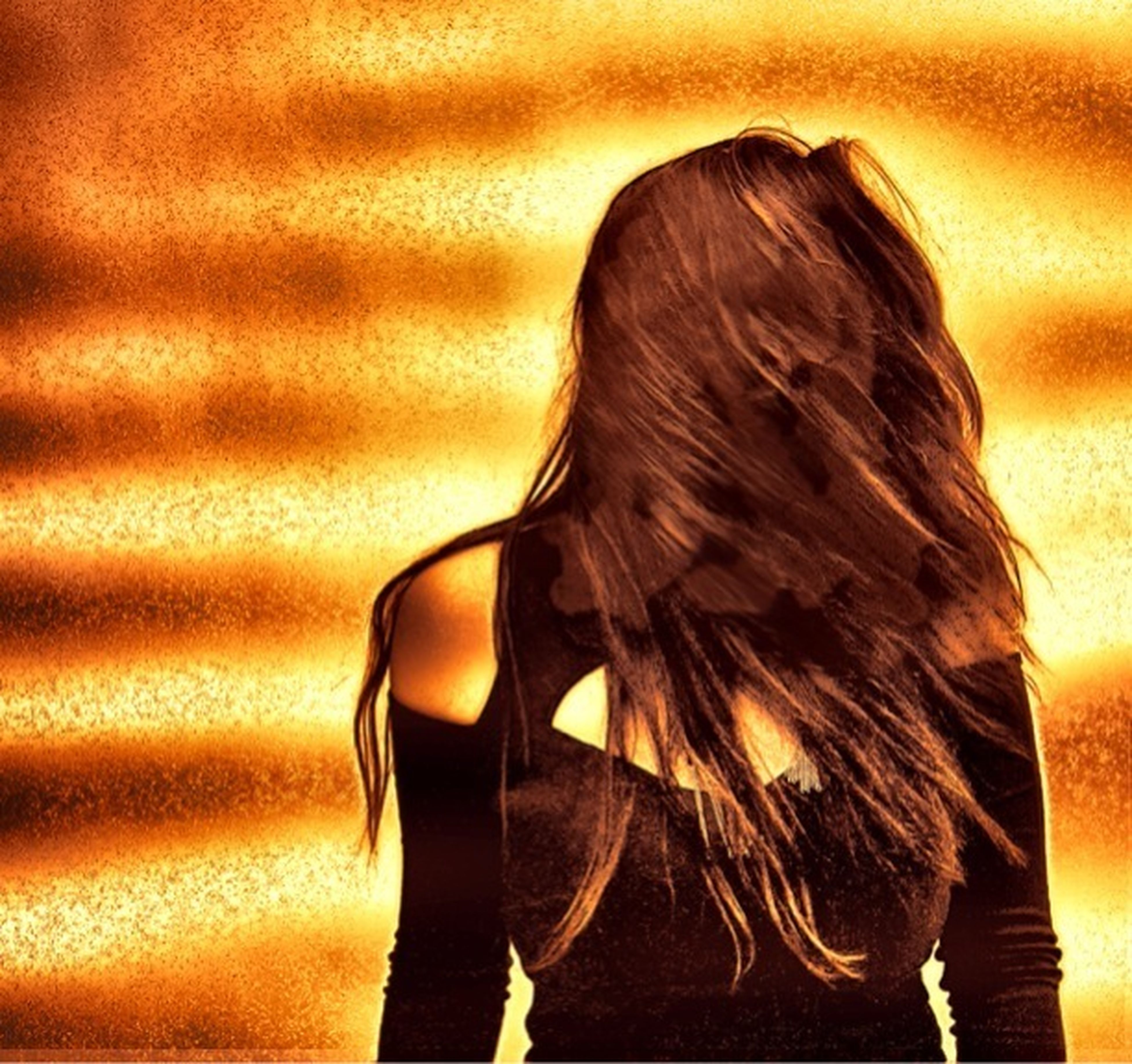 long hair, lifestyles, young women, leisure activity, rear view, headshot, waist up, person, young adult, indoors, standing, casual clothing, side view, obscured face, focus on foreground, human hair, close-up, contemplation