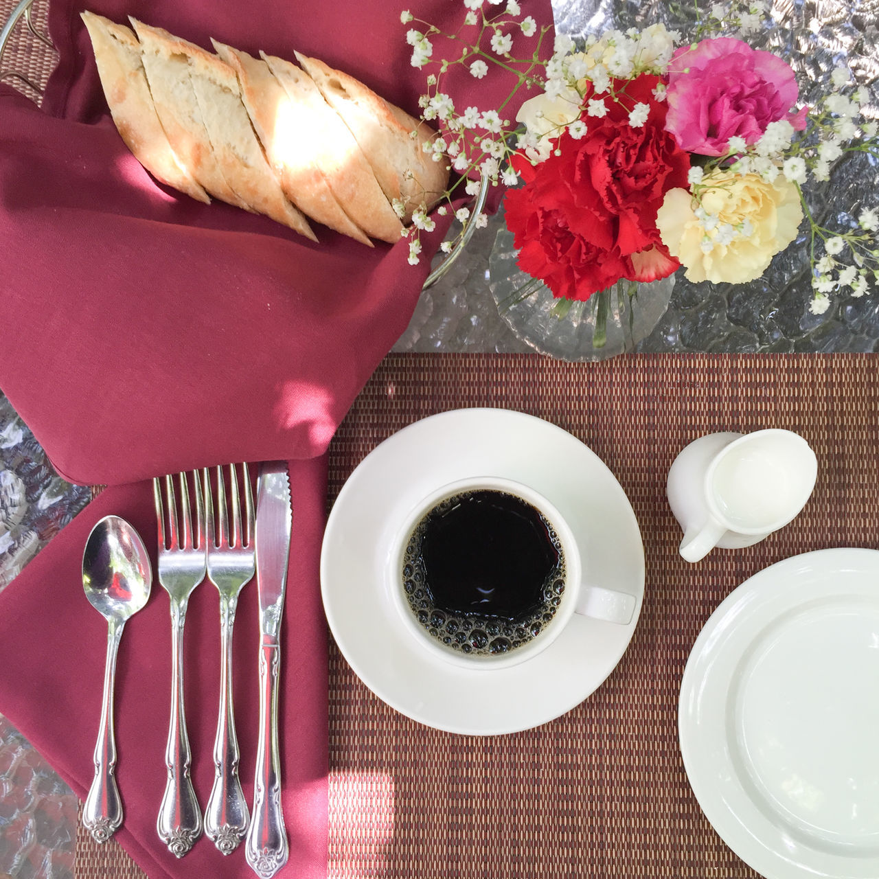Close-up Coffee Time Dining Table Eating Utensil Flower Flower Arrangement Food And Drink French Bread On Table Freshness High Angle View No People Place Setting Plate Still Life Table Tablecloth