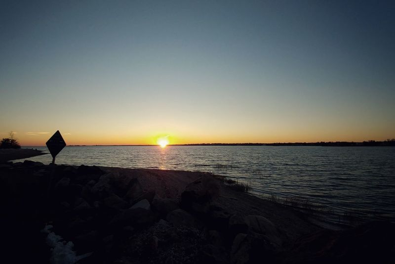 Such a warm enough day to make a quick stop at the beach. Sea Scenics Silhouette Horizon Over Water Sunset Tranquility Clear Sky Tranquil Scene Beauty In Nature Nature Sun Travel Destinations No People Sky Water Outdoors Vacations Beach Day