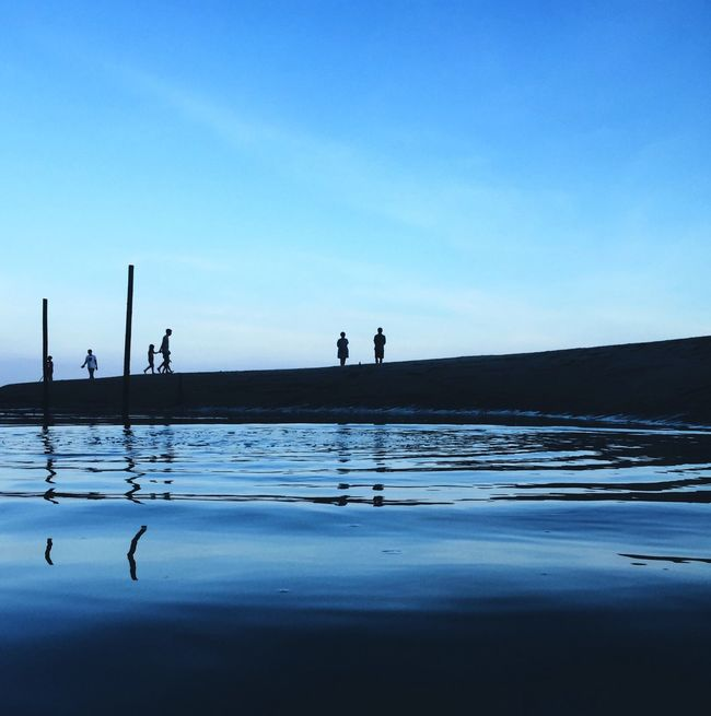 DONGSHAN ISLAND- 旅志 Silhouette Reflection Water Blue Mid Distance Unrecognizable Person Waterfront Outline Tranquility Tranquil Scene Cloud Calm Day Scenics Sky Outdoors Surface Level Standing Water Tall