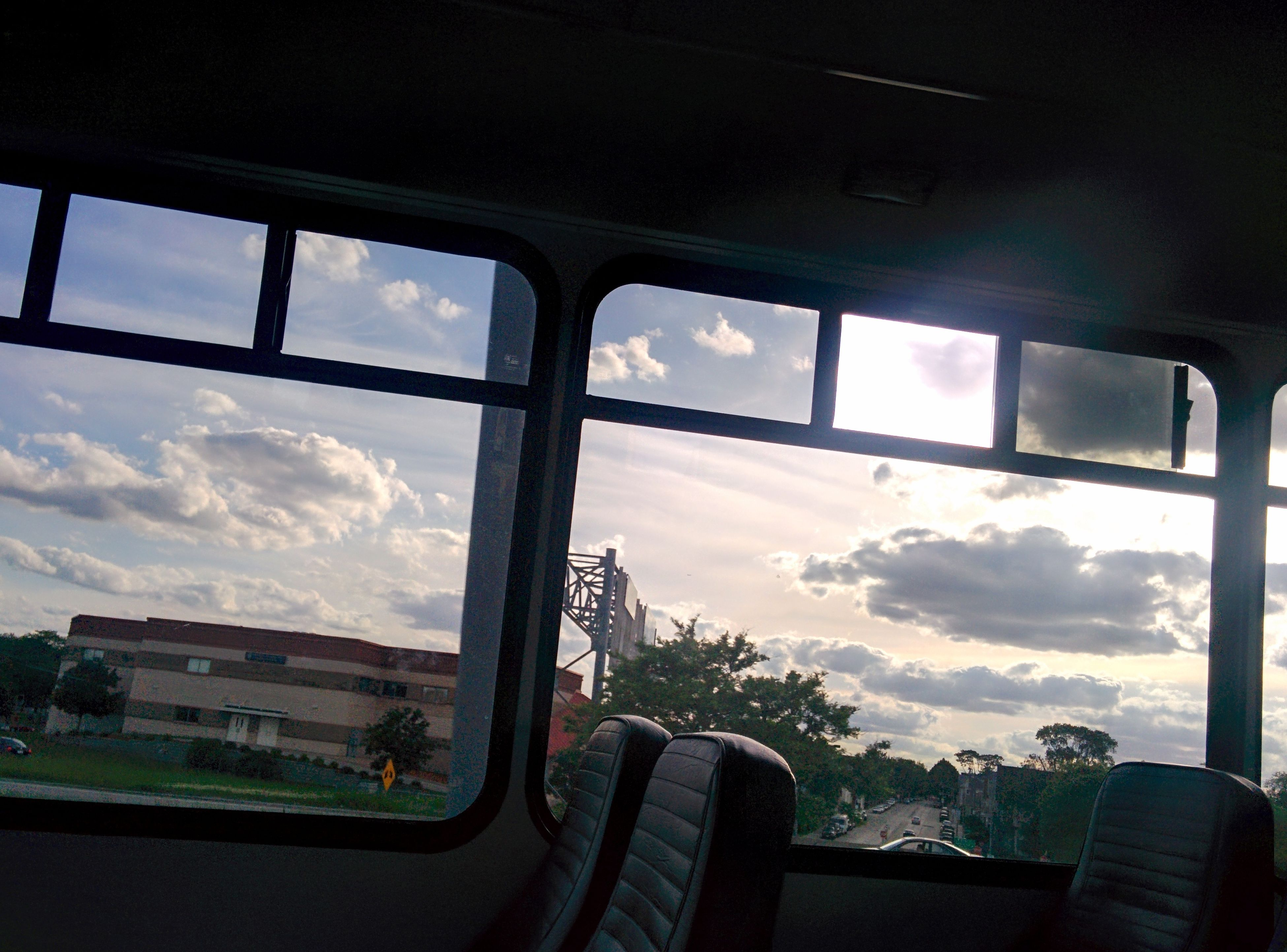 window, transportation, vehicle interior, mode of transport, glass - material, sky, transparent, car, land vehicle, indoors, cloud - sky, travel, airplane, cloud, journey, public transportation, car interior, windshield, part of, day