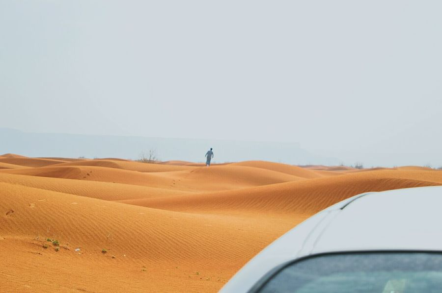 Sand Car Arid Climate Sand Dune Road Trip Day Rural Scene Beautiful People One Man Only Cheerful Passion Fashion ModelRoad Sky Beauty In Nature Desert Transportation Landscape Nature Loneliness Travel Adventure